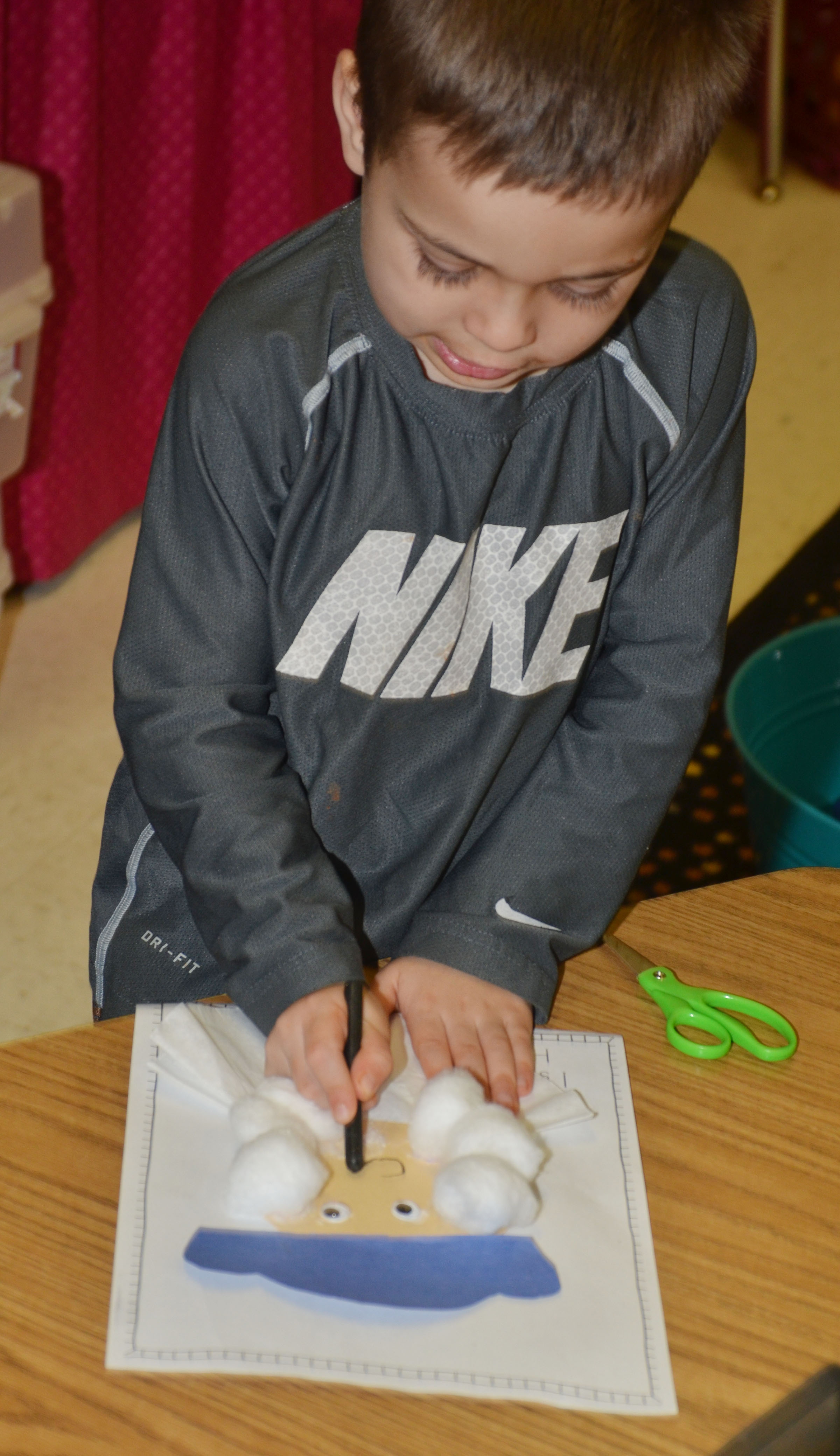 CES kindergartener Michael Terry adds a mouth on his George Washington figure.