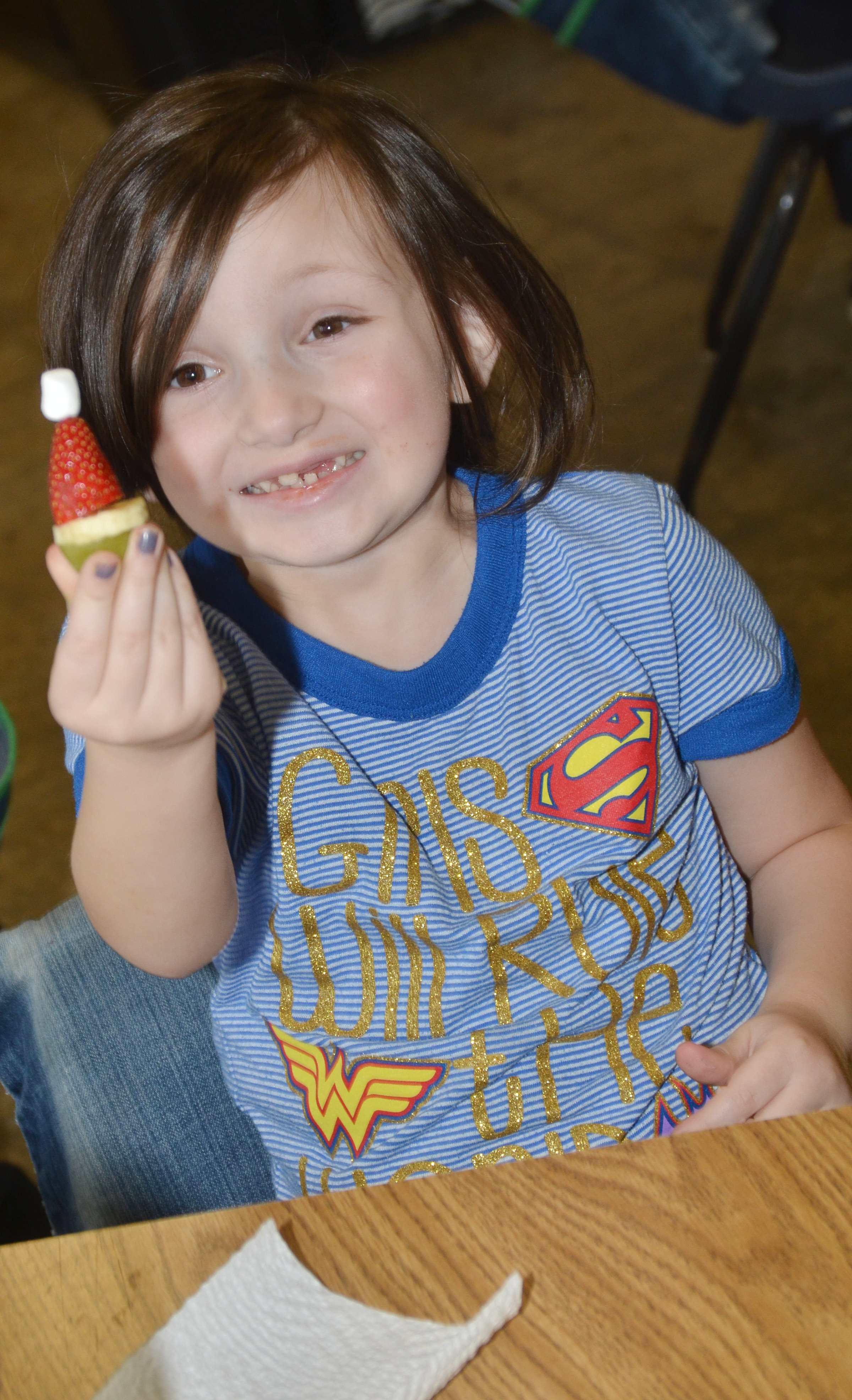 CES kindergartener Abigail Smith holds her Grinch snack.