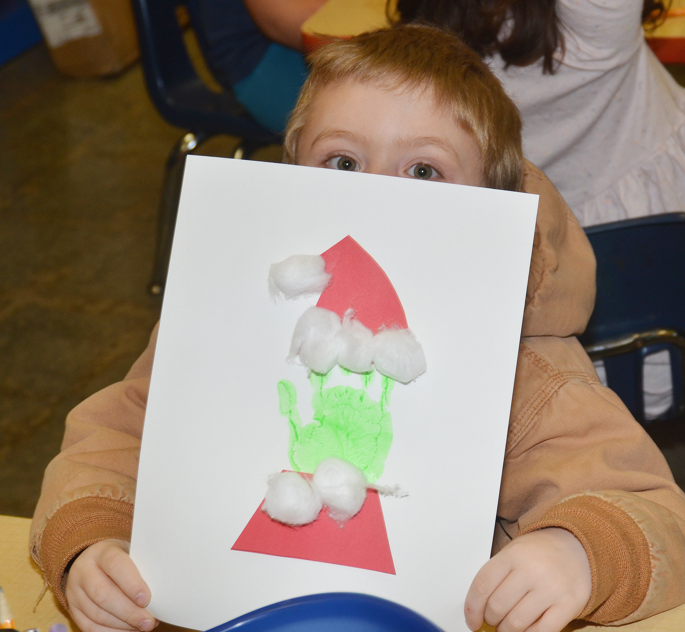CES kindergartener Alex Newcomb holds his Grinch.
