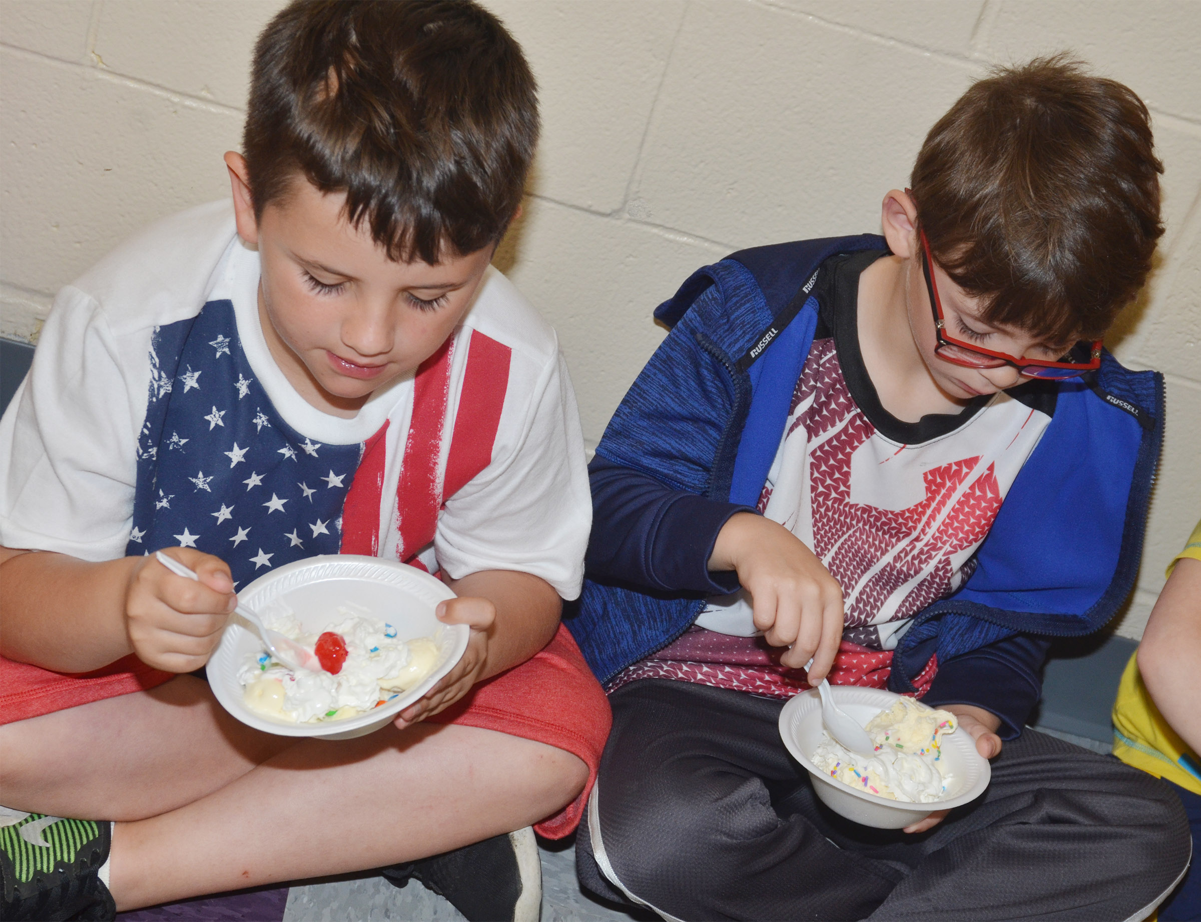 CES kindergarteners Casen Meredith, at left, and Bentley Shively enjoy their ice cream sundaes.