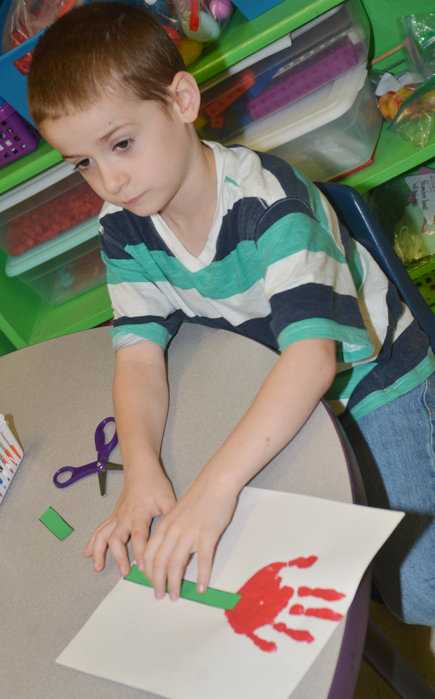CES kindergartener Greyson Trulock makes his Mother's Day flower.