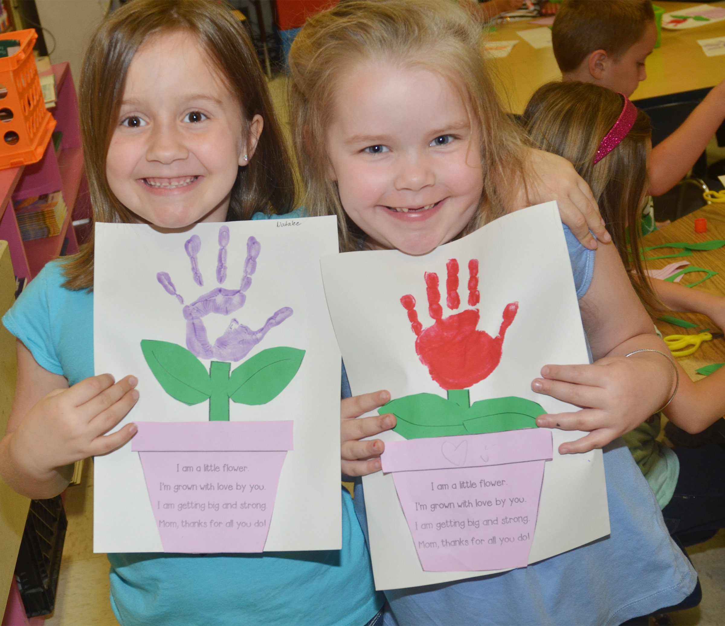 CES kindergarteners Natalee Shaw, at left, and Cera Rooker hold their Mother's Day flowers.