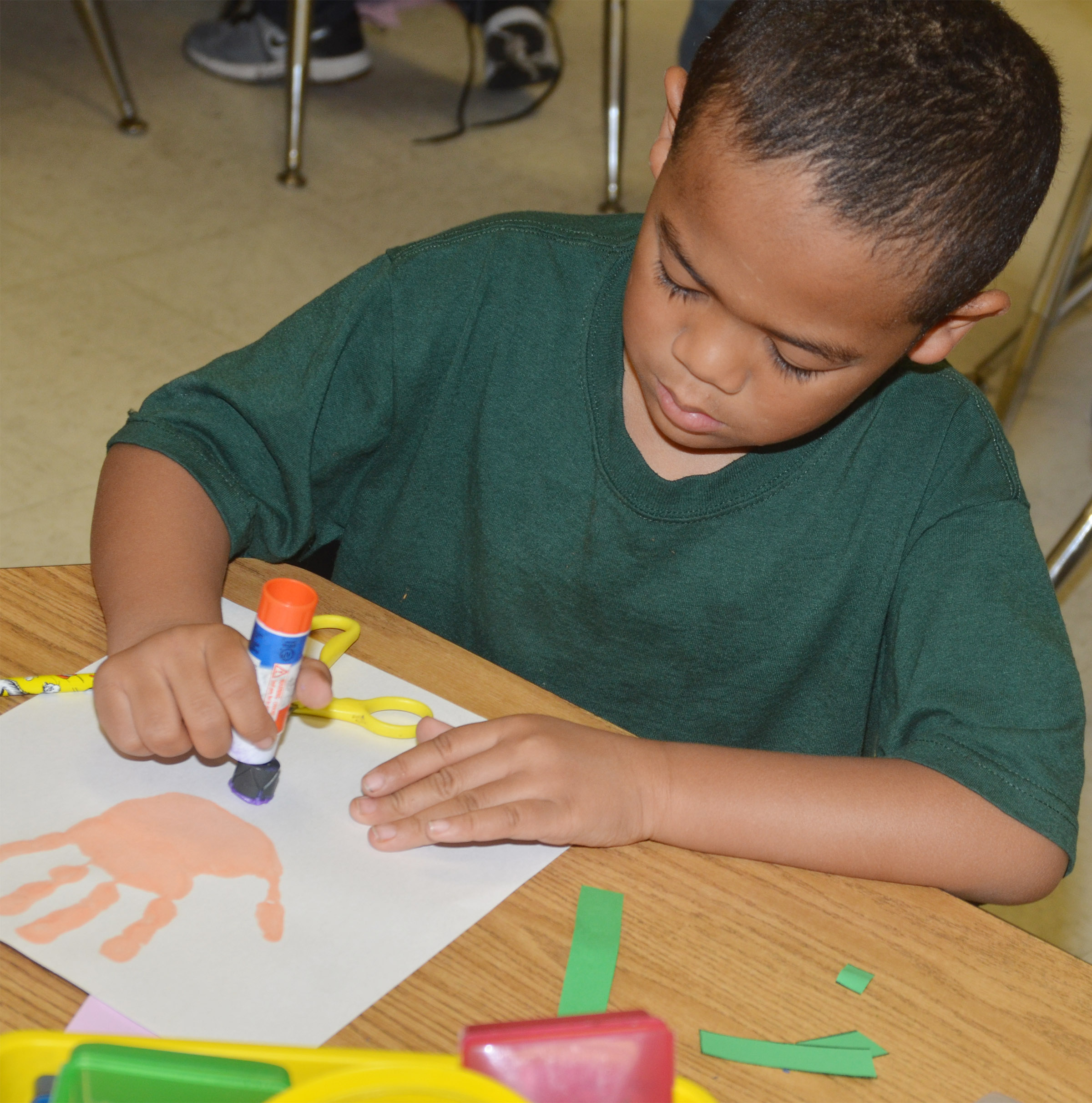 CES kindergartener Tyler Branch makes his Mother's Day flower.