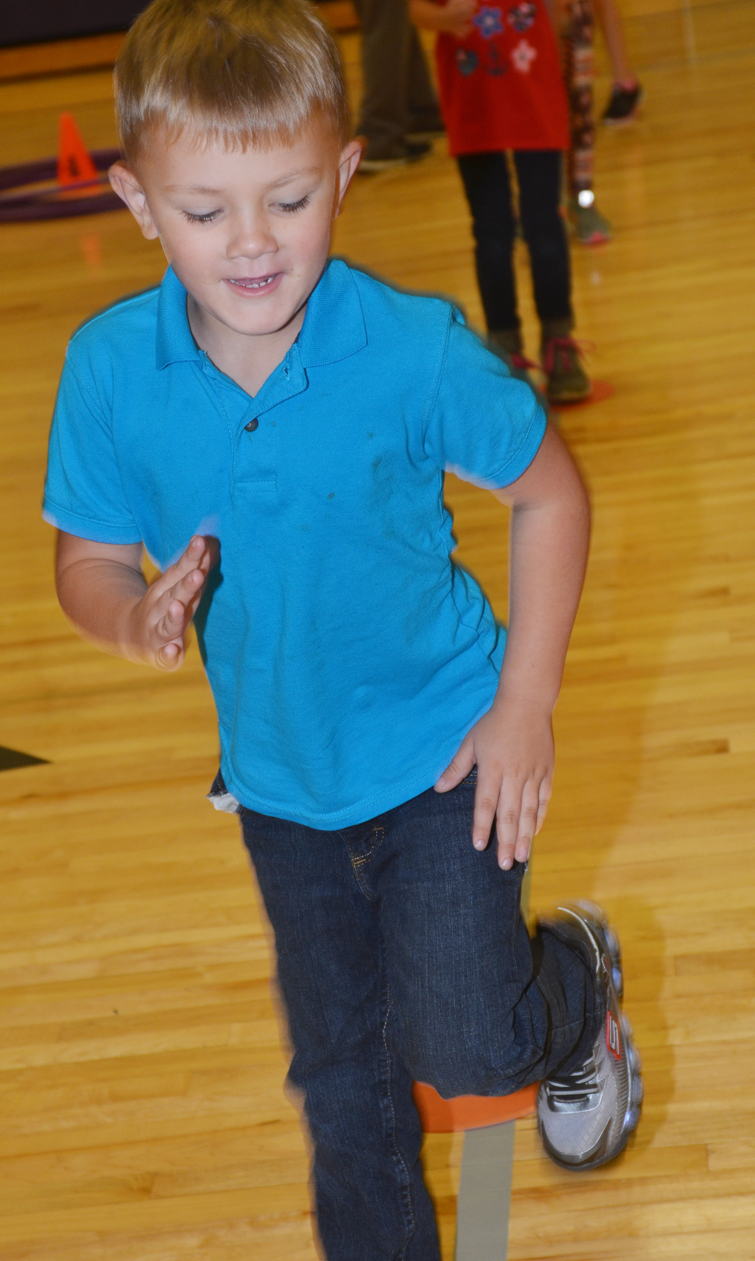 CES kindergartener Brayden Taylor runs in place.