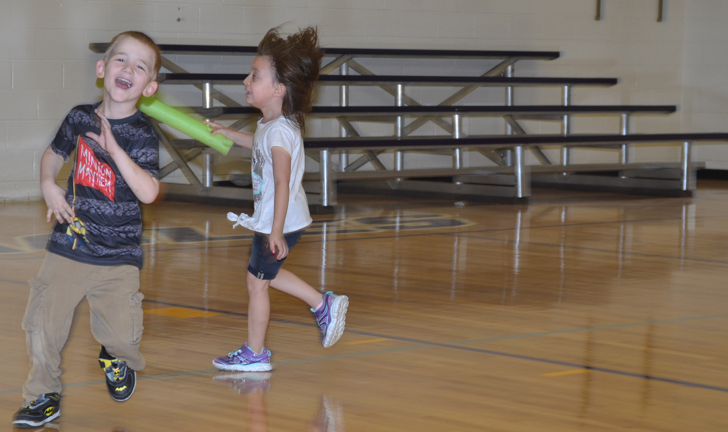 CES kindergartener Mason Edwards runs as he plays noodle tag.