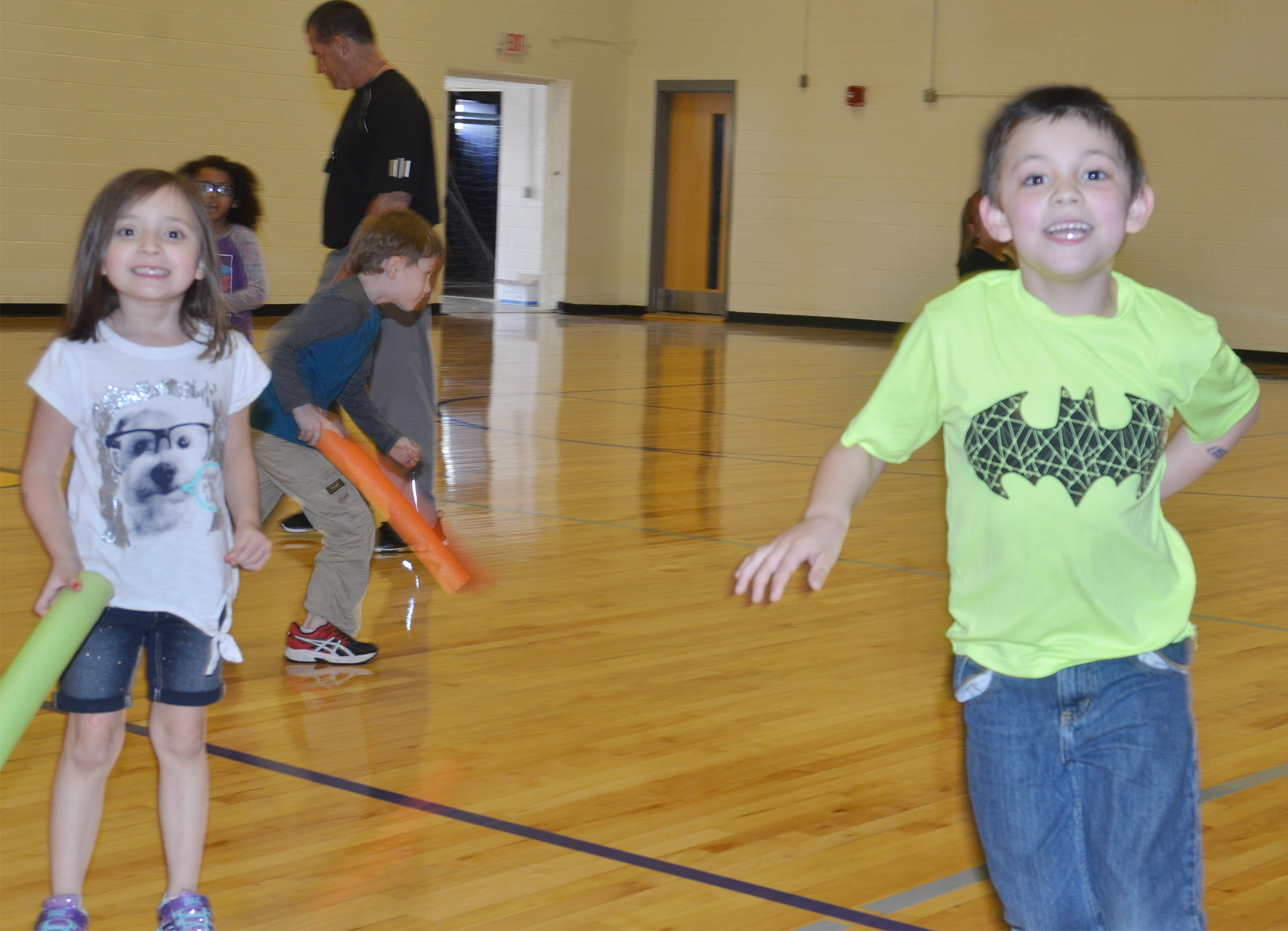 CES kindergarteners Gabriella Tate, at left, and Keagan Shearer play noodle tag.