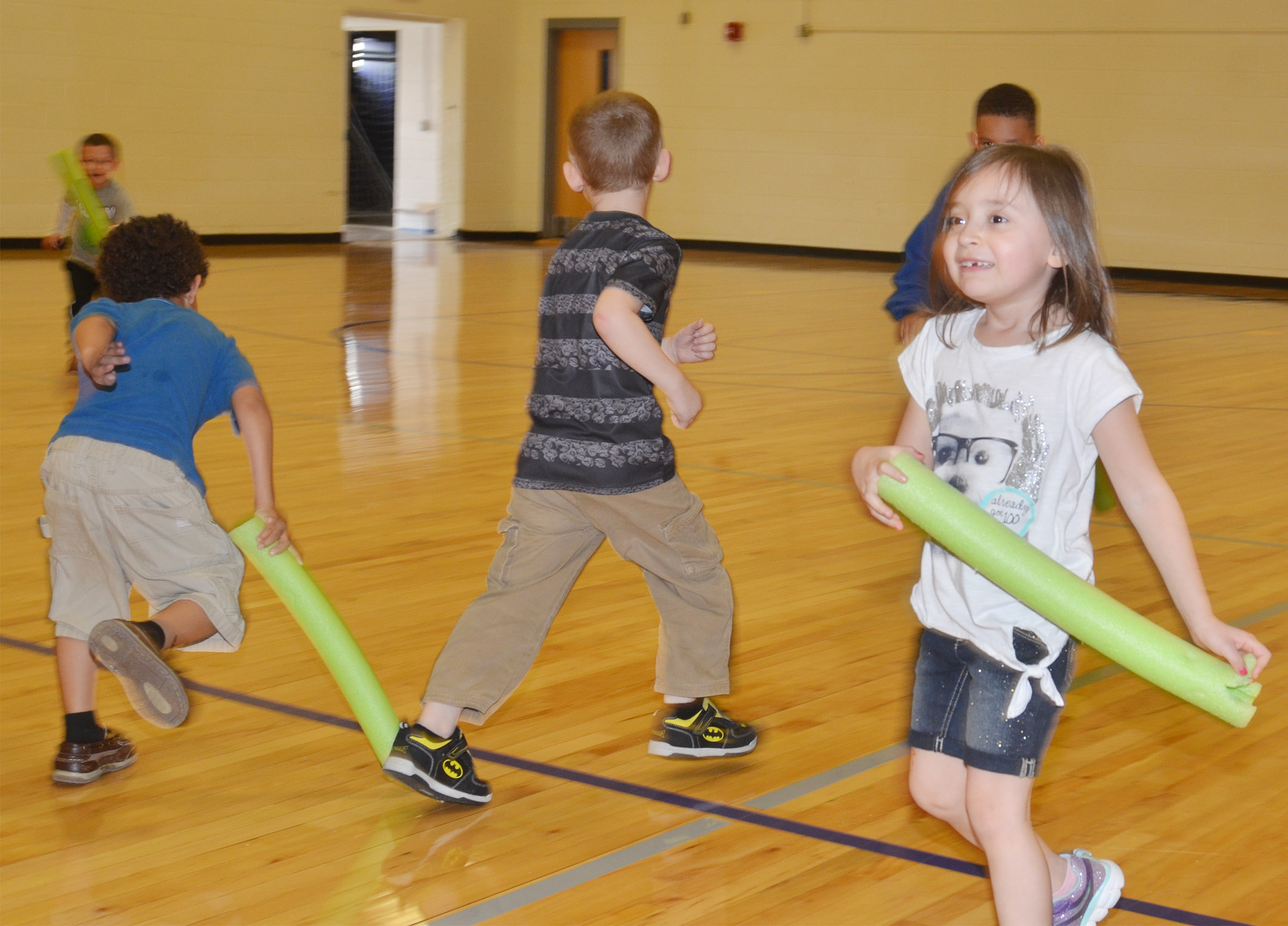 CES kindergartener Gabriella Tate runs as she plays noodle tag.