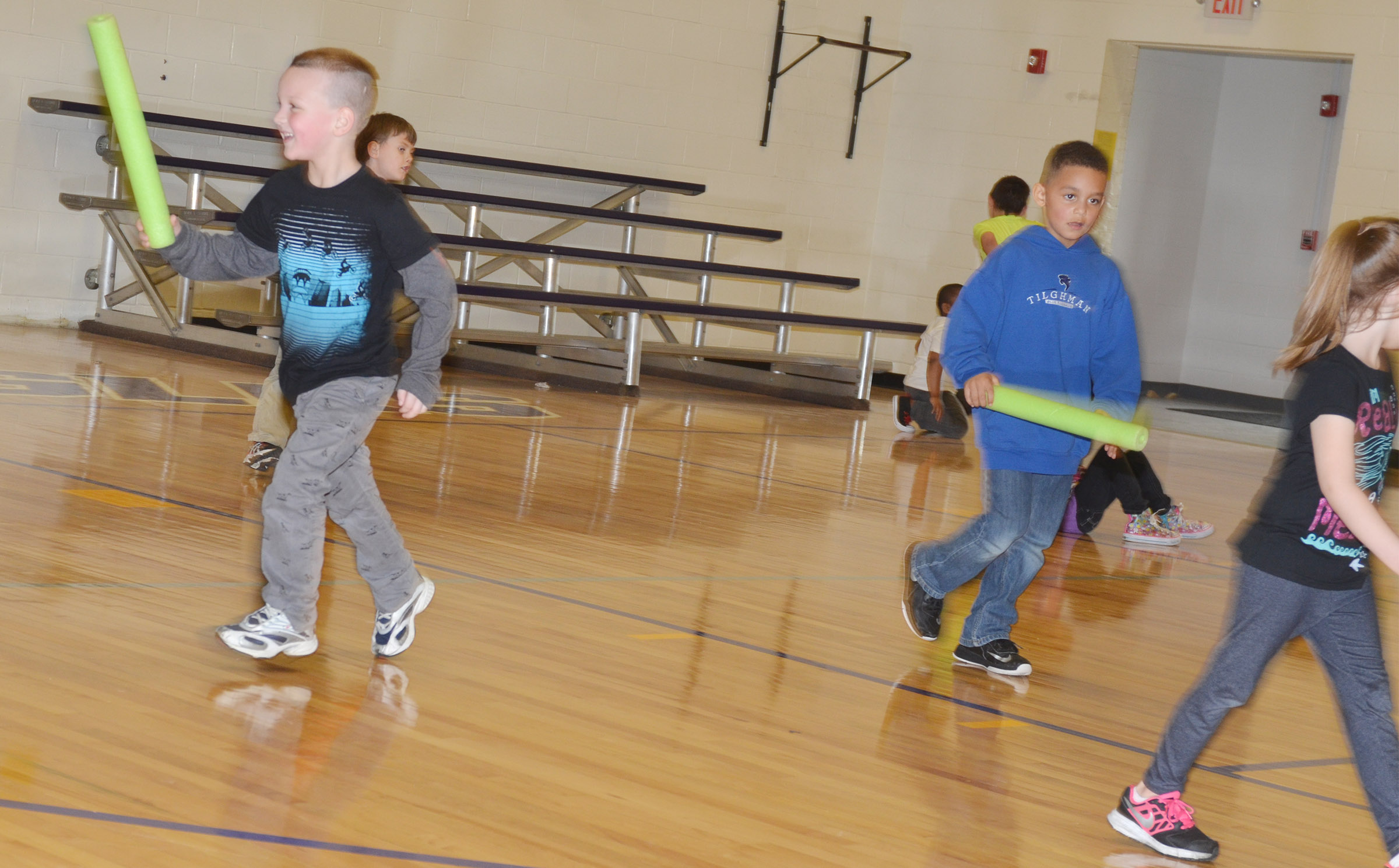 CES kindergarteners Justice Nelson, at left, and Quincy Travis run with their classmates as they play noodle tag.