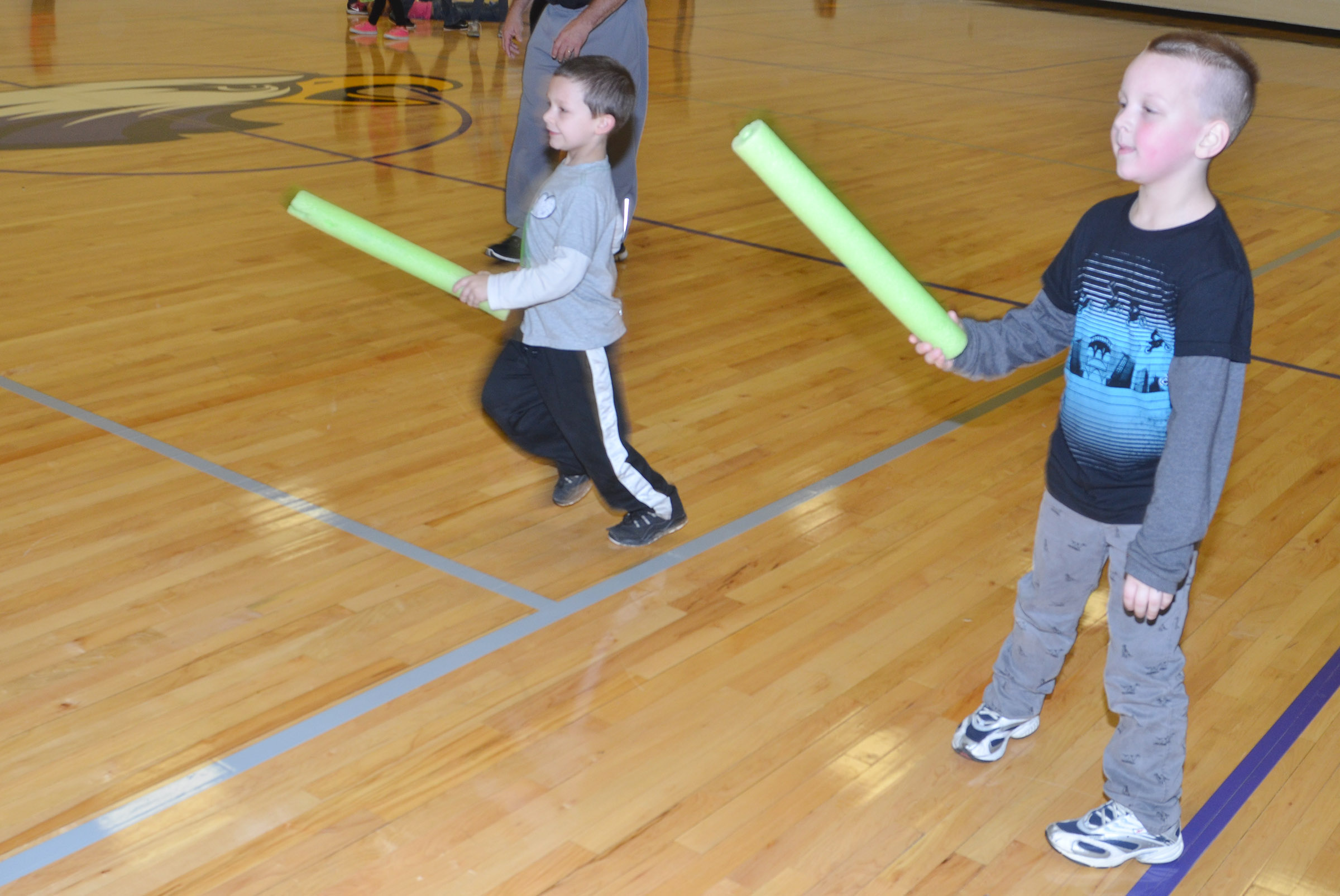 CES kindergartener Justice Nelson plays noodle tag with his classmates.