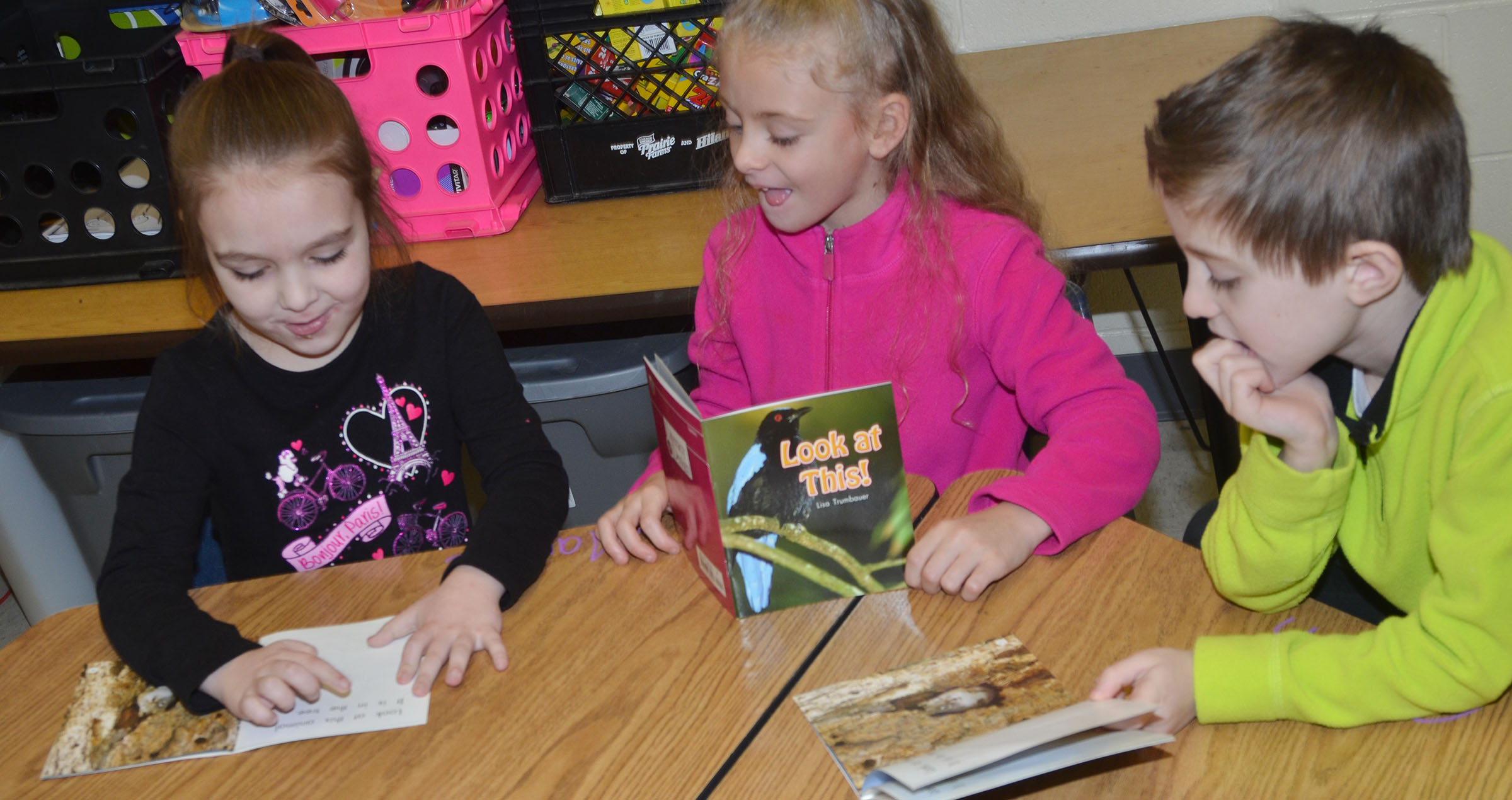 CES kindergarteners, from left, Aubrey Allen, Aliyah Litsey and Caleb Goodson read together in their reading group.