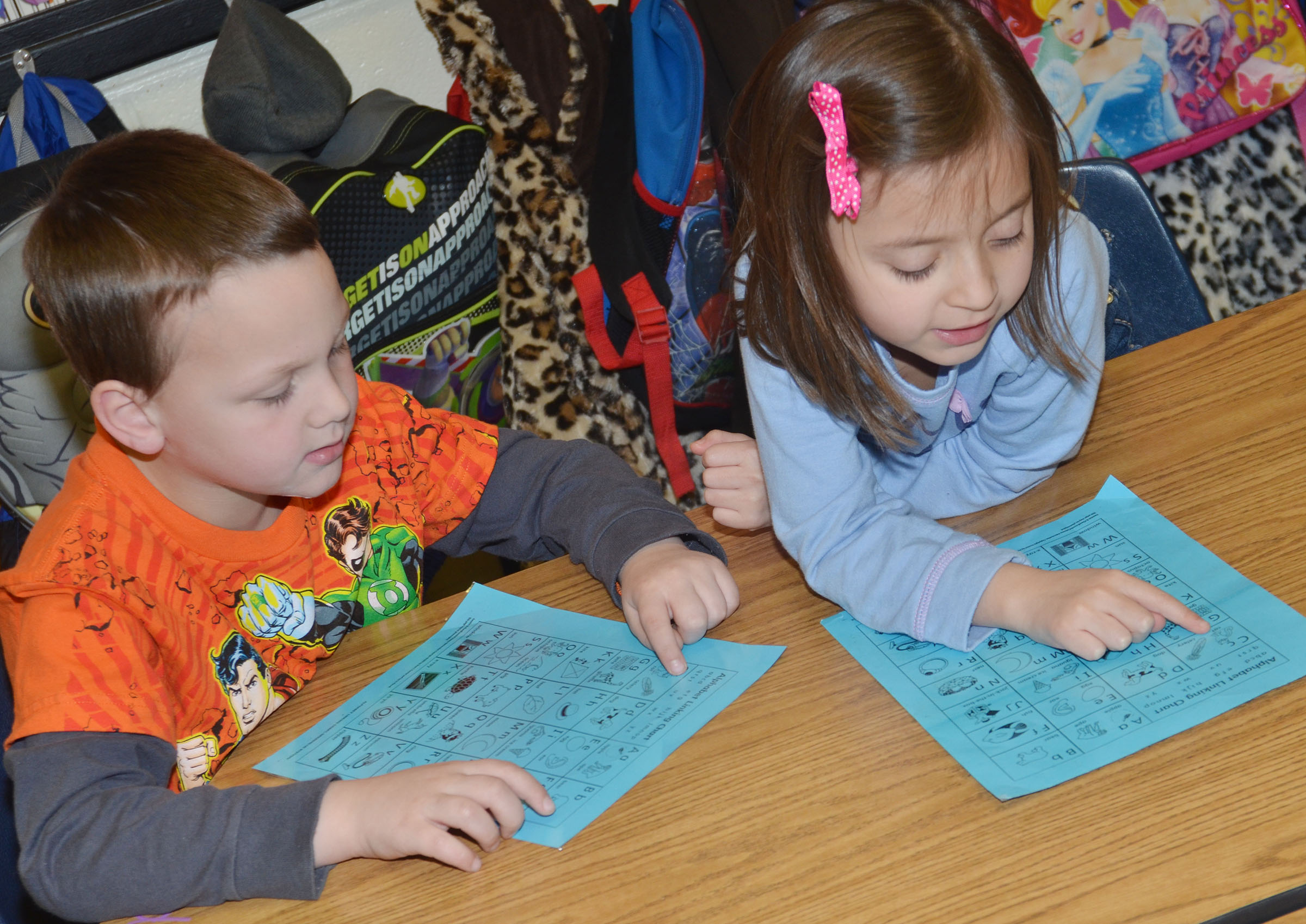 CES kindergarteners Justice Nelson, at left, and Nevaeh Agent recite the alphabet in their reading group.