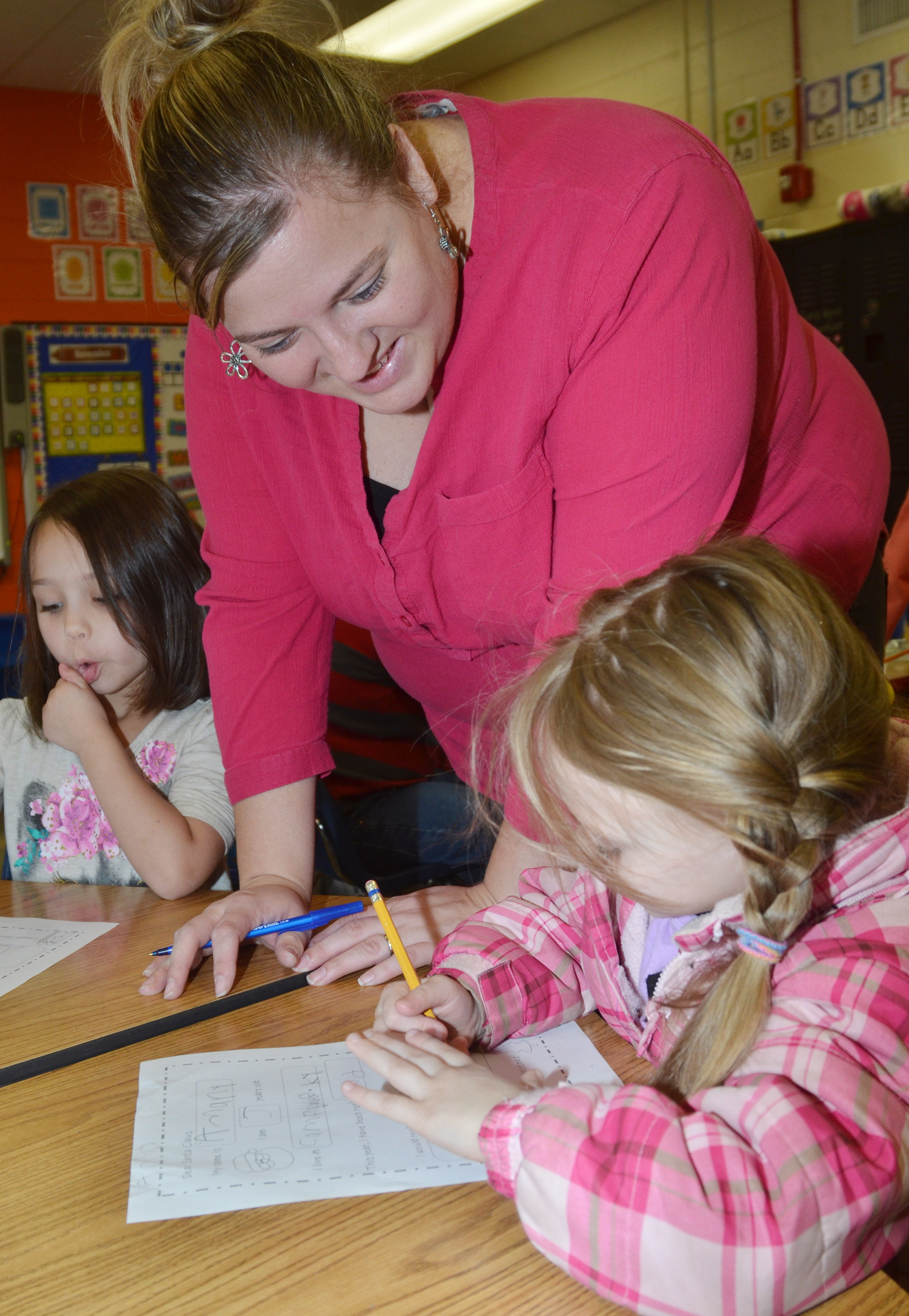 CES kindergarten teacher Kimberly Clark helps Amary Tompkins write her letter to Santa.