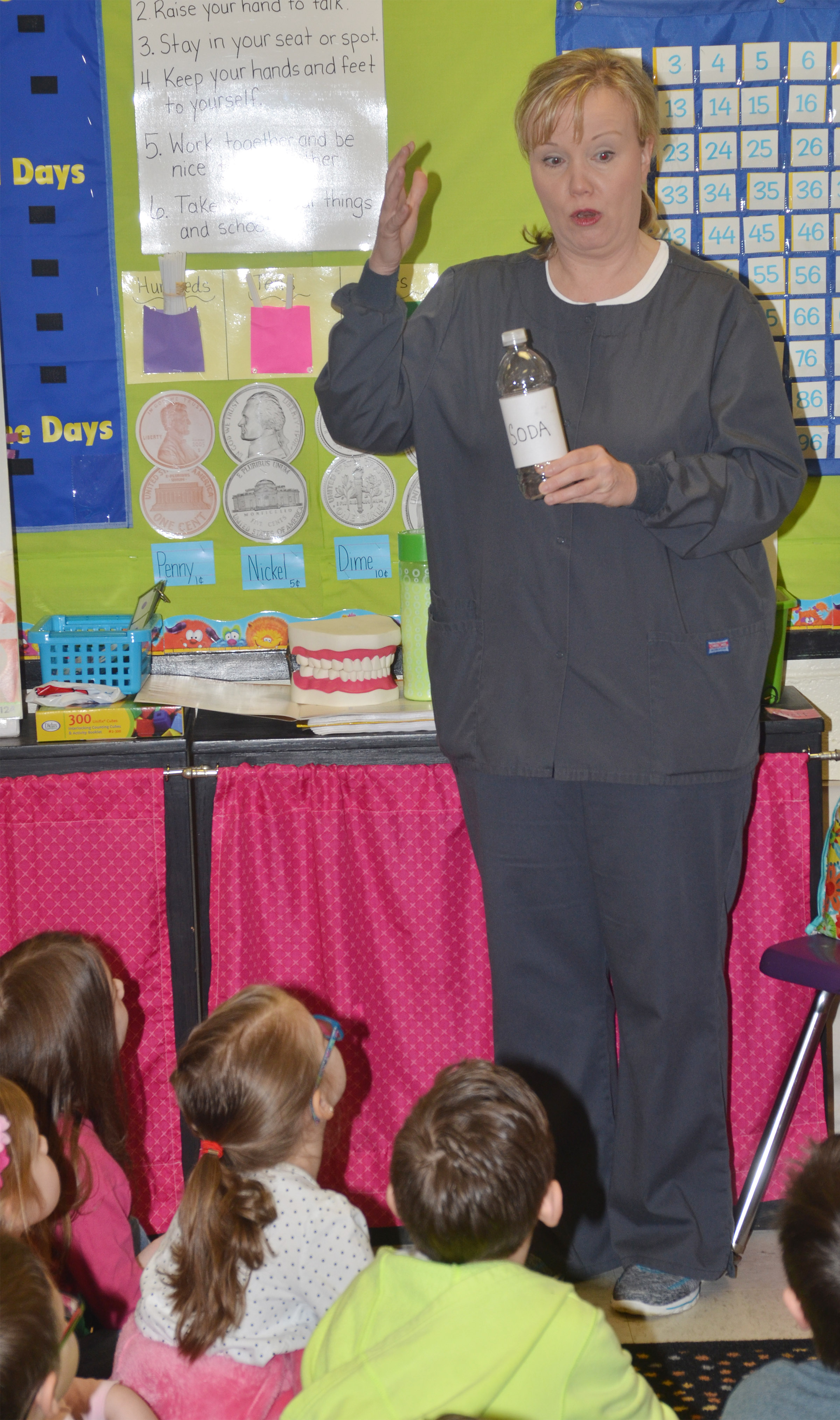 Dental hygienist Jennifer White, who works at Dr. Randy Smoot's dental office in Campbellsville, talks to CES kindergarteners about how much sugar is in soda.