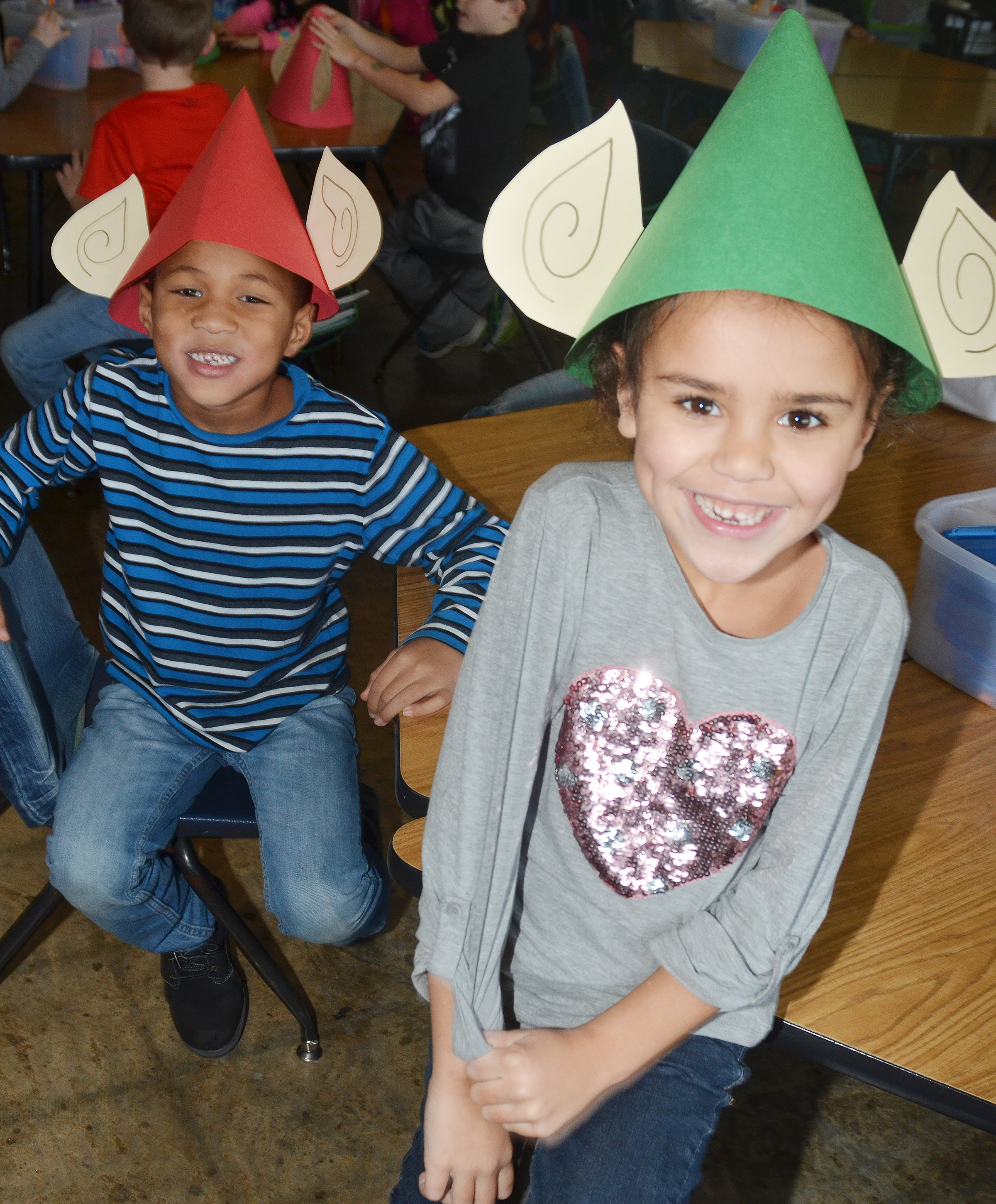 CES kindergarteners Jamerius Miller, at left, and Adelyn Litsey model their elf hats.