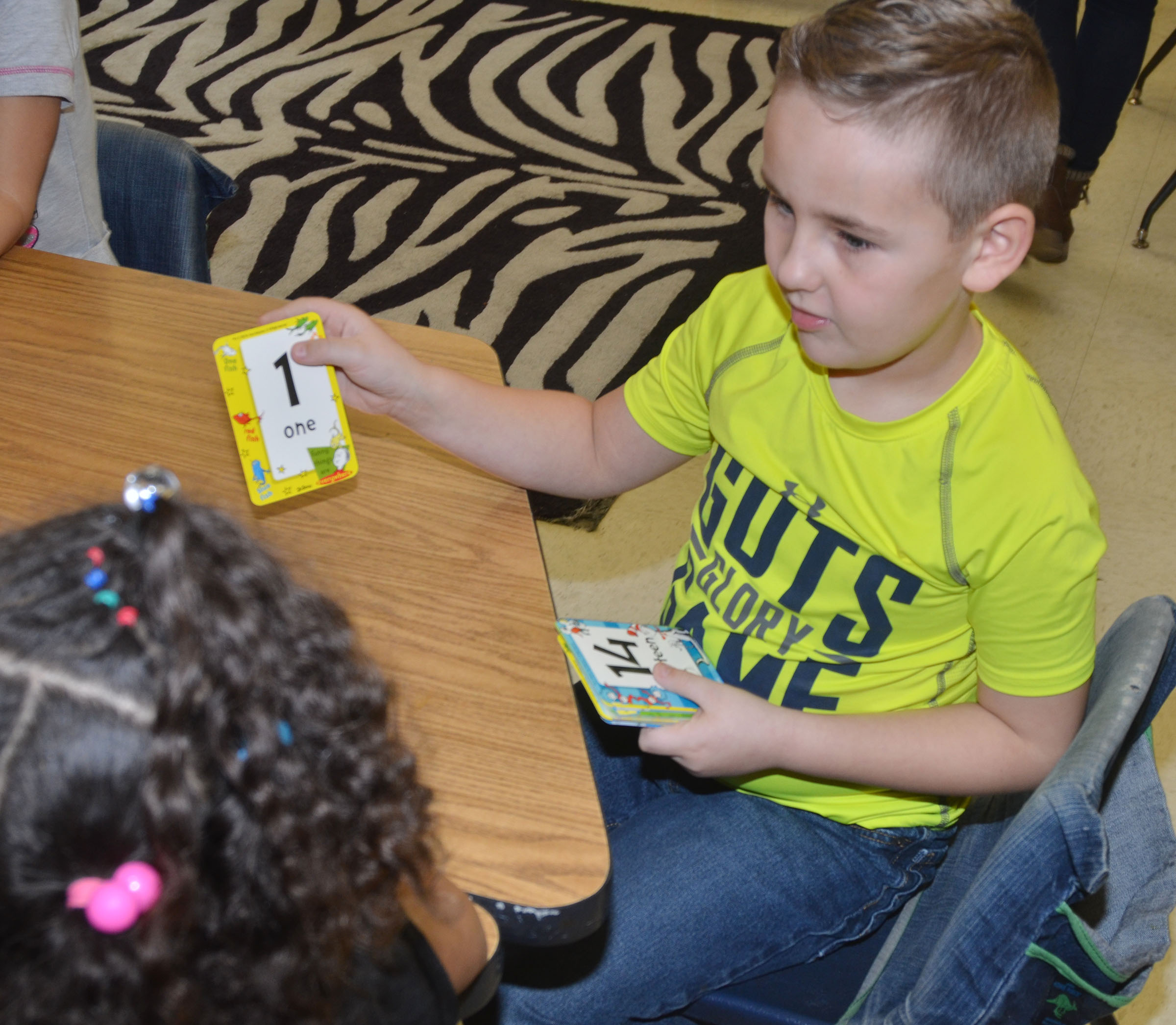 CES kindergartener Braxton Rhodes plays a math card game.