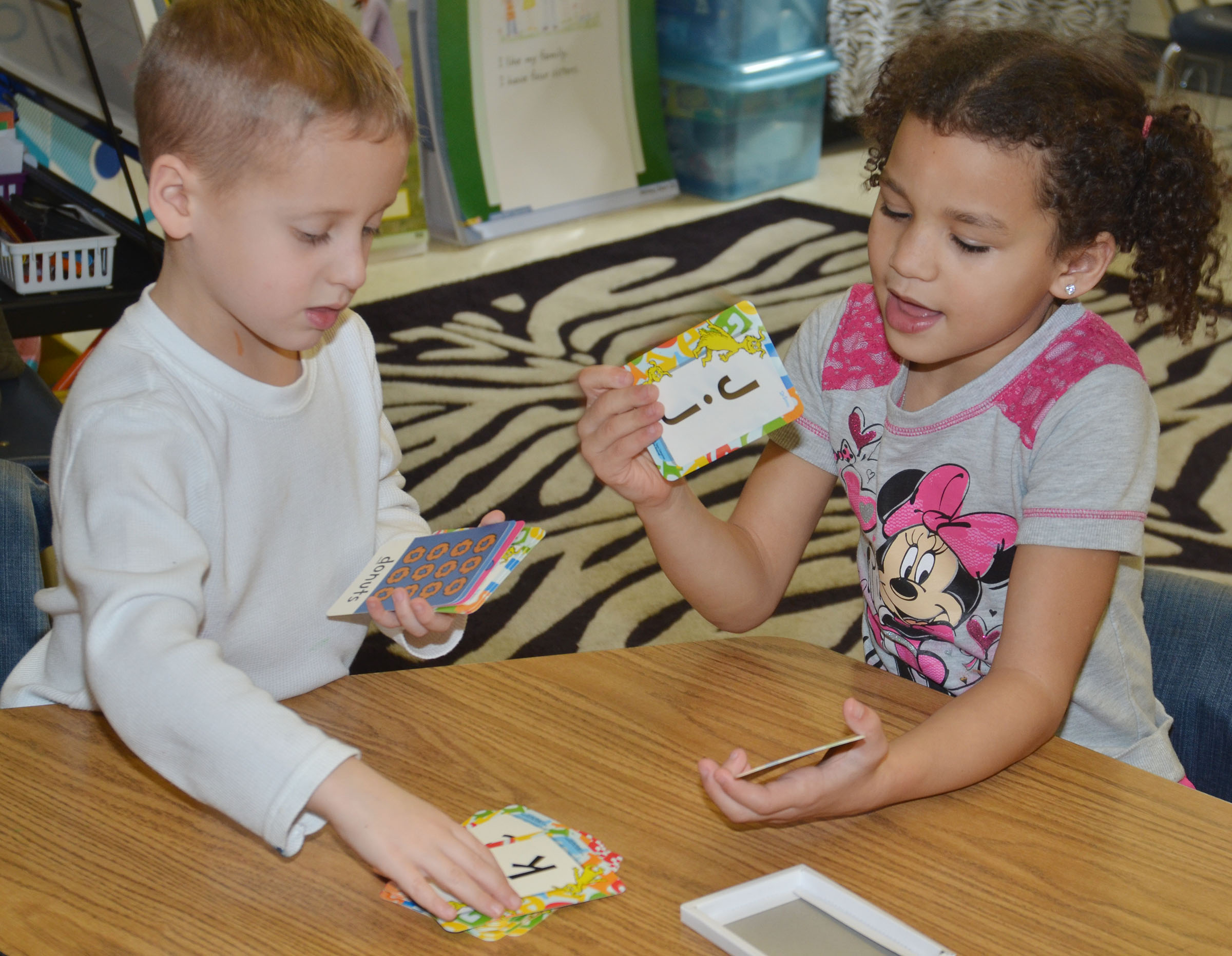 CES kindergarteners Gavin Paris and Aleeya Spaulding play a math card game.