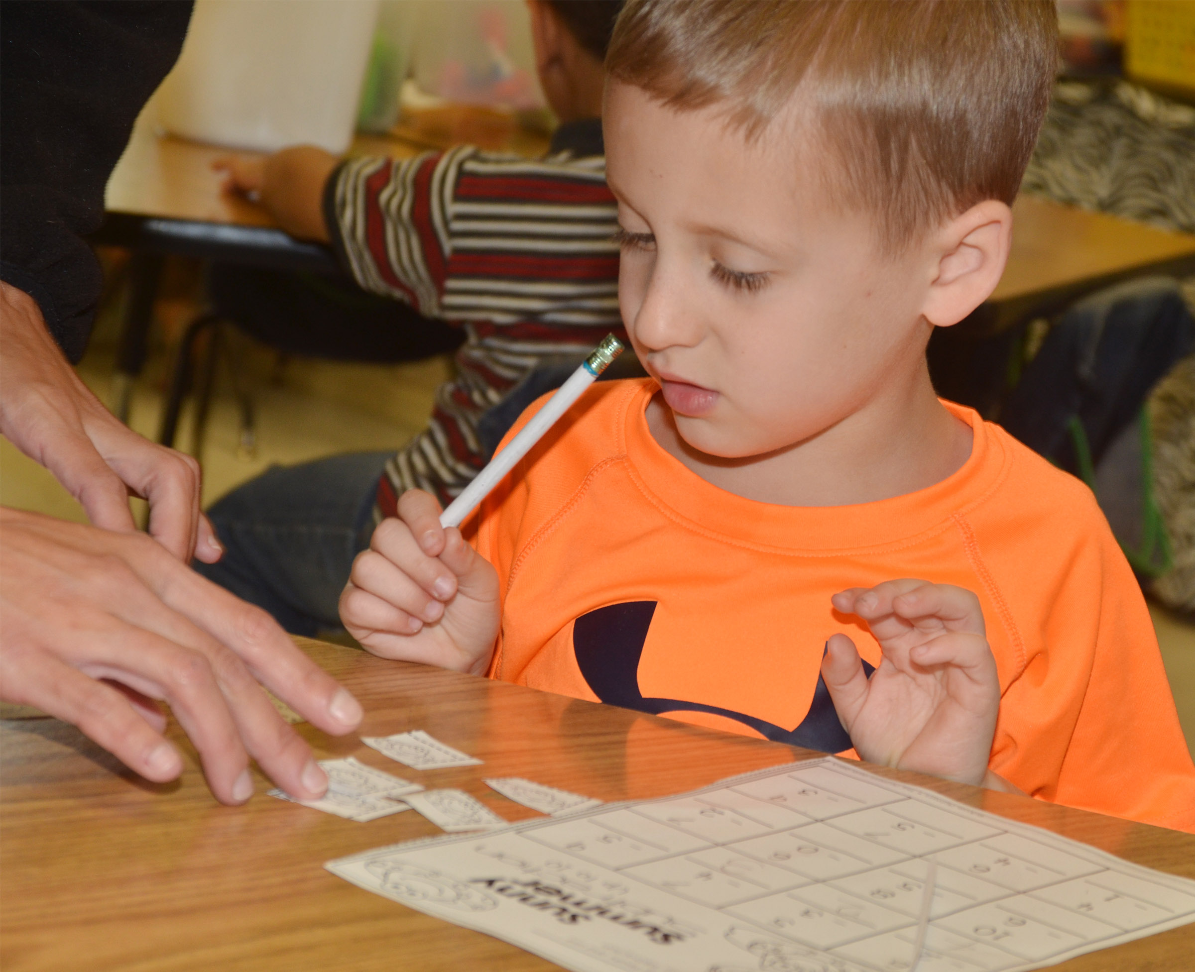 CES kindergartener Gavin Paris uses pictures to help him work a subtraction problem.