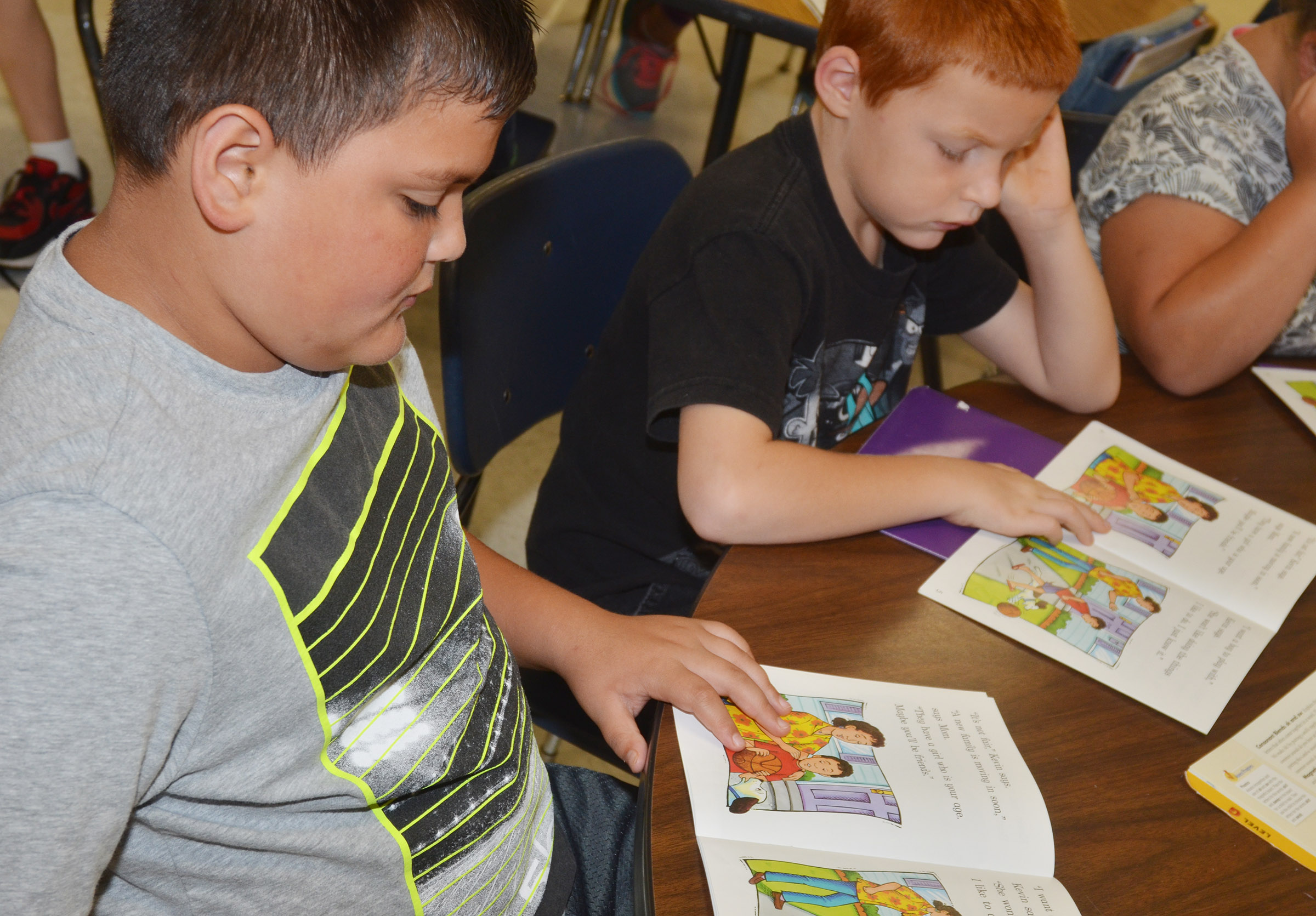 "CES second-graders Eric Mixtega, at left, and Carter Wethington read ""A New Friend."""