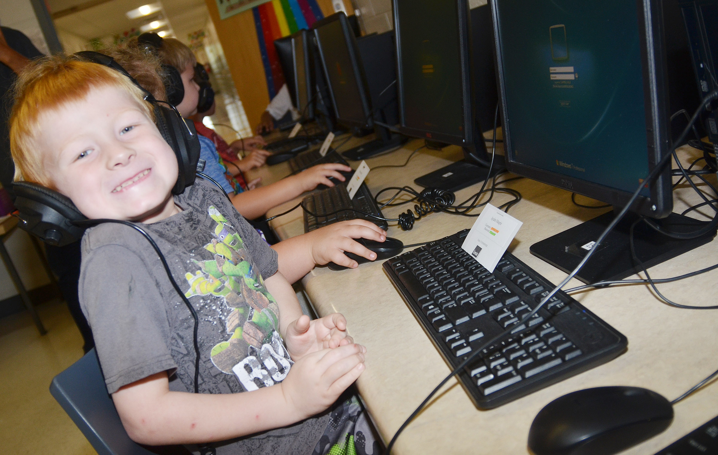 CES first-grader Jayden Maupin is all smiles after learning how to log on his computer.