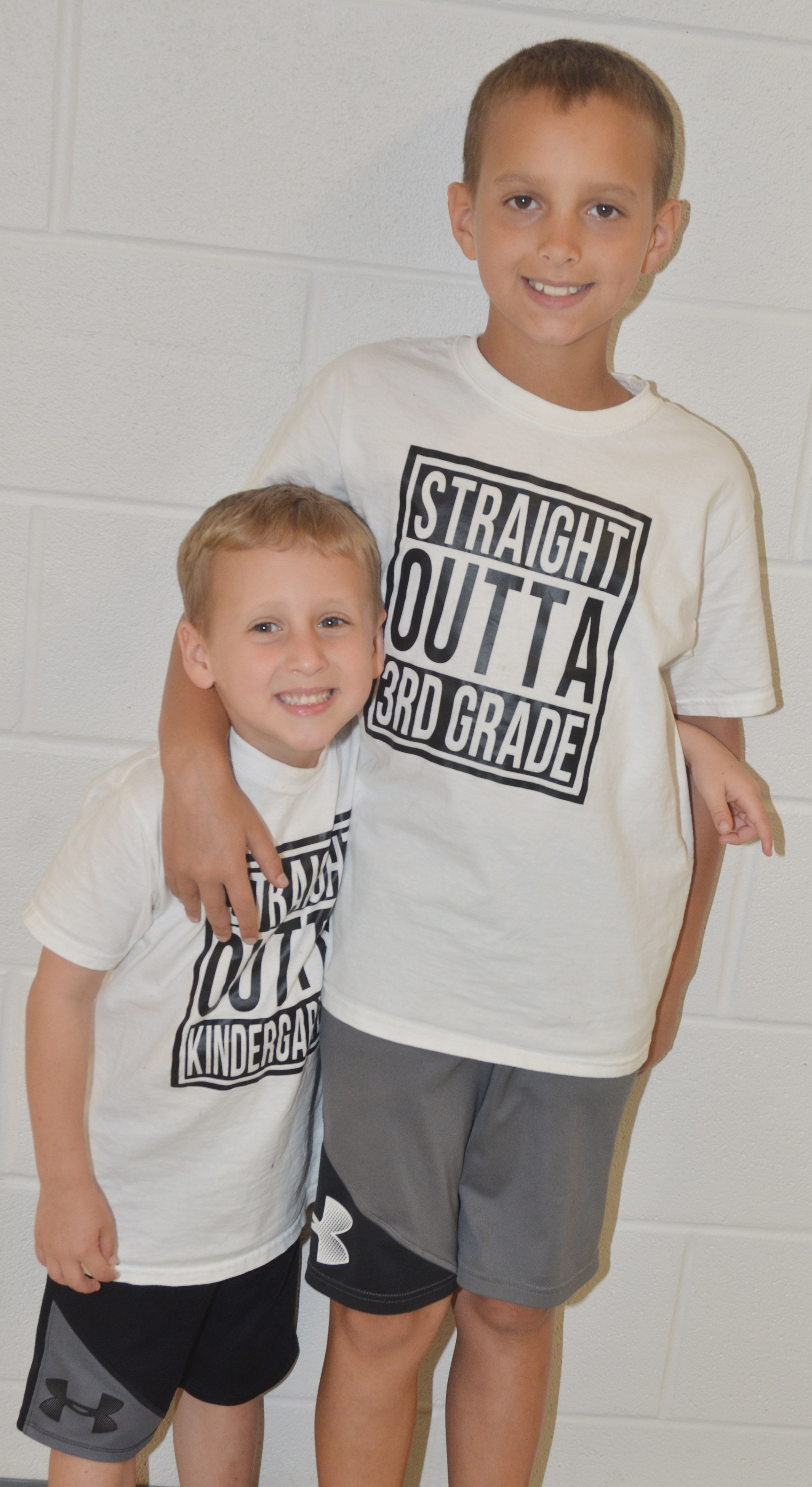CES kindergartener Gavin Paris, at left, and his brother, third-grader Bradley Paris, wore special shirts to celebrate the last day of school.