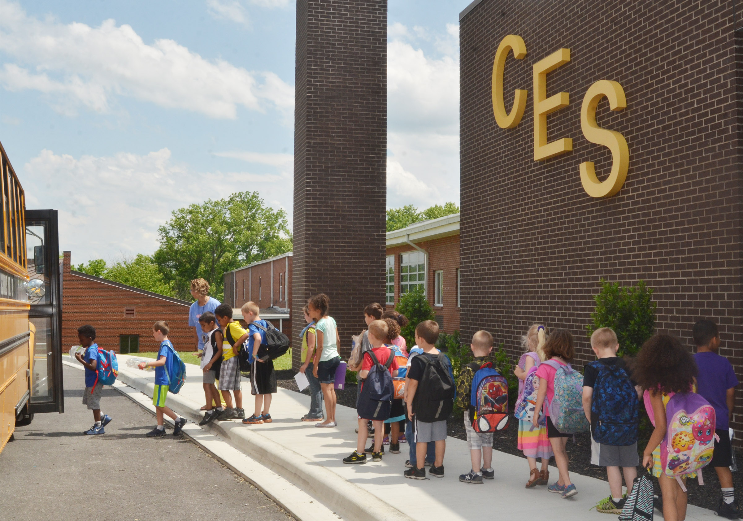 CES students board the bus after the school day ends.