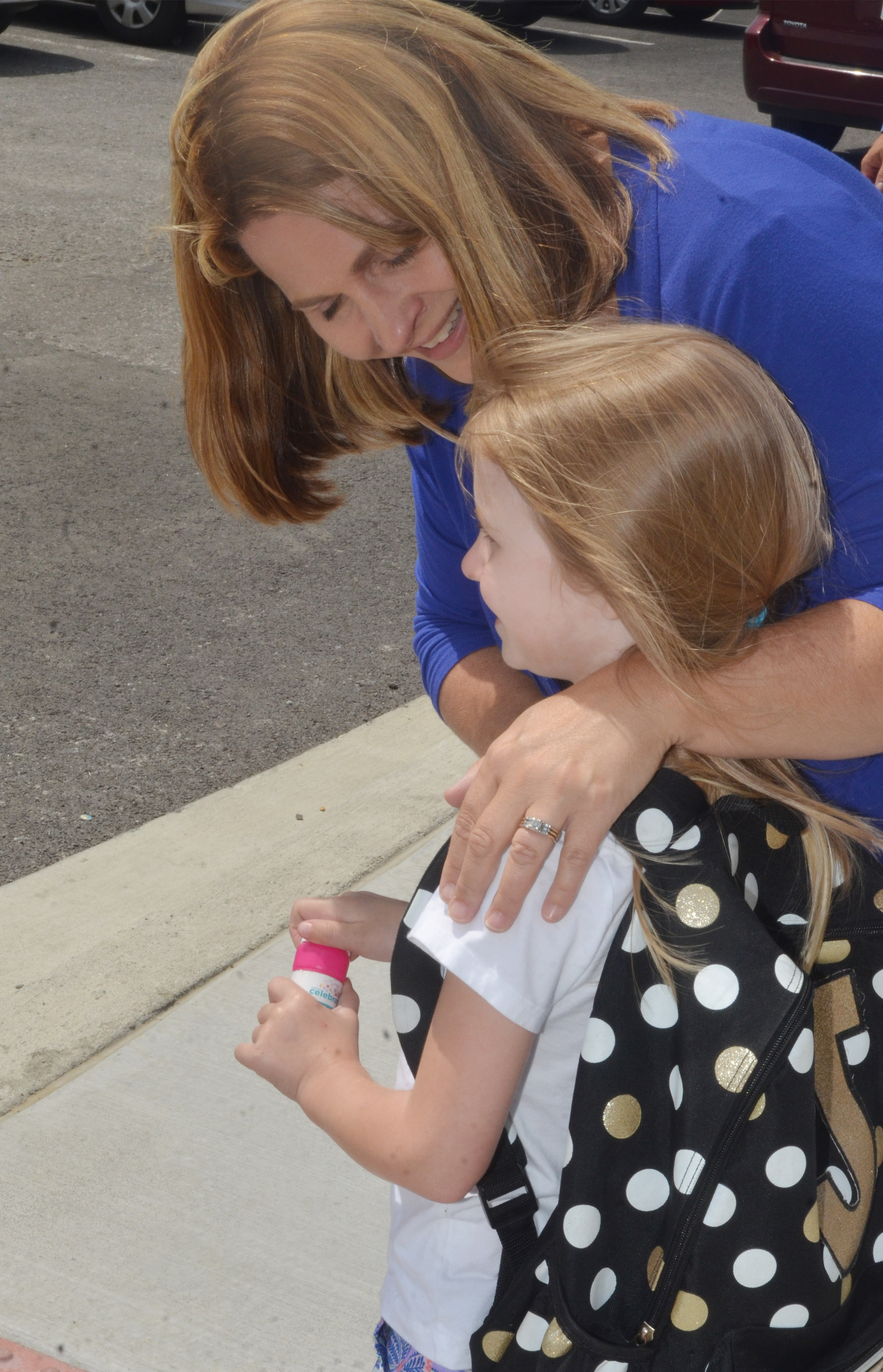 CES Guidance Counselor Sonya Orberson talks to kindergartener Jewell Brewster as she waits for her ride home.