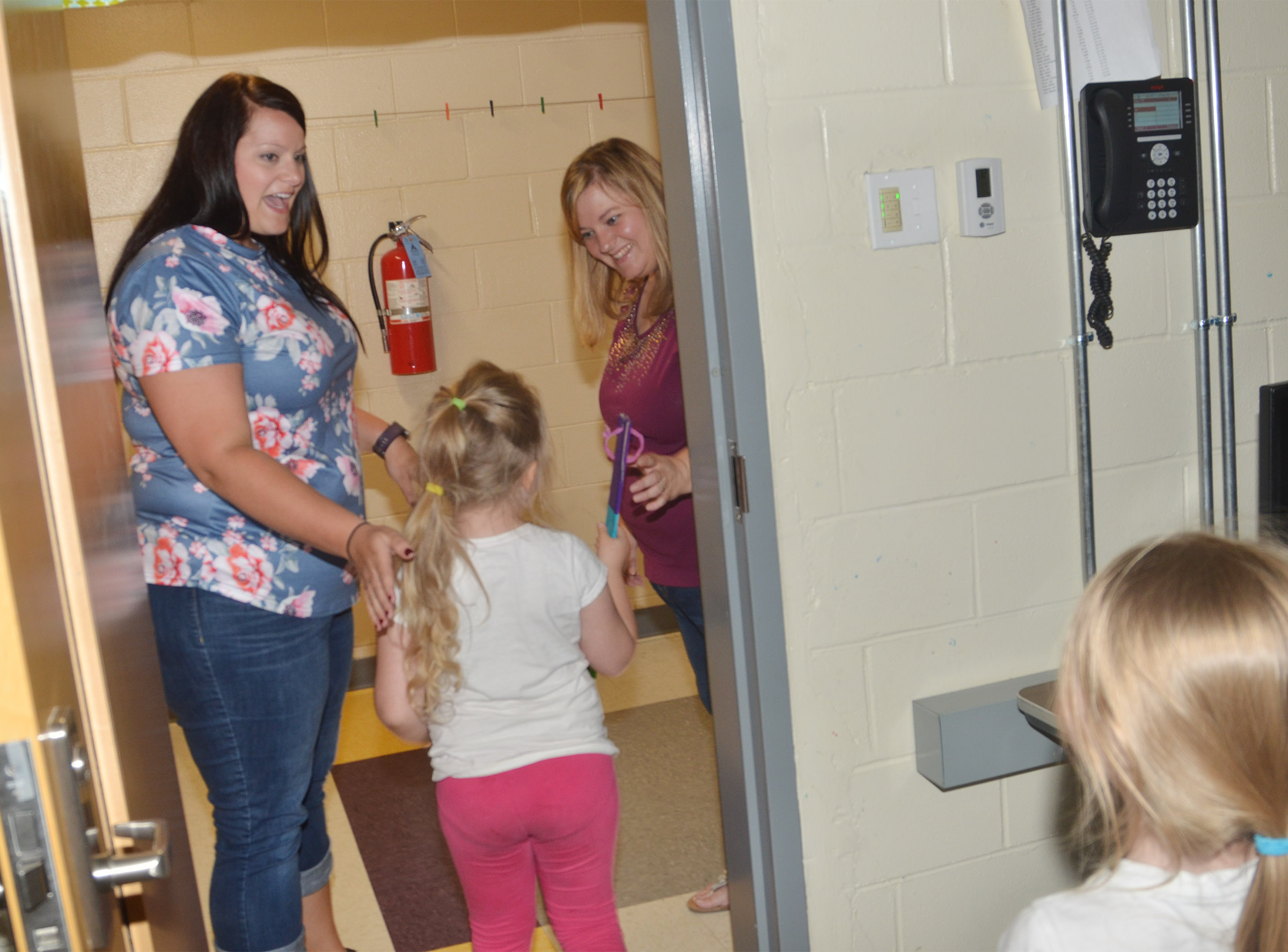 CES Explorers teacher Miriah Cox says goodbye to Kimberly Clark's kindergarten students as her class ends for the day.