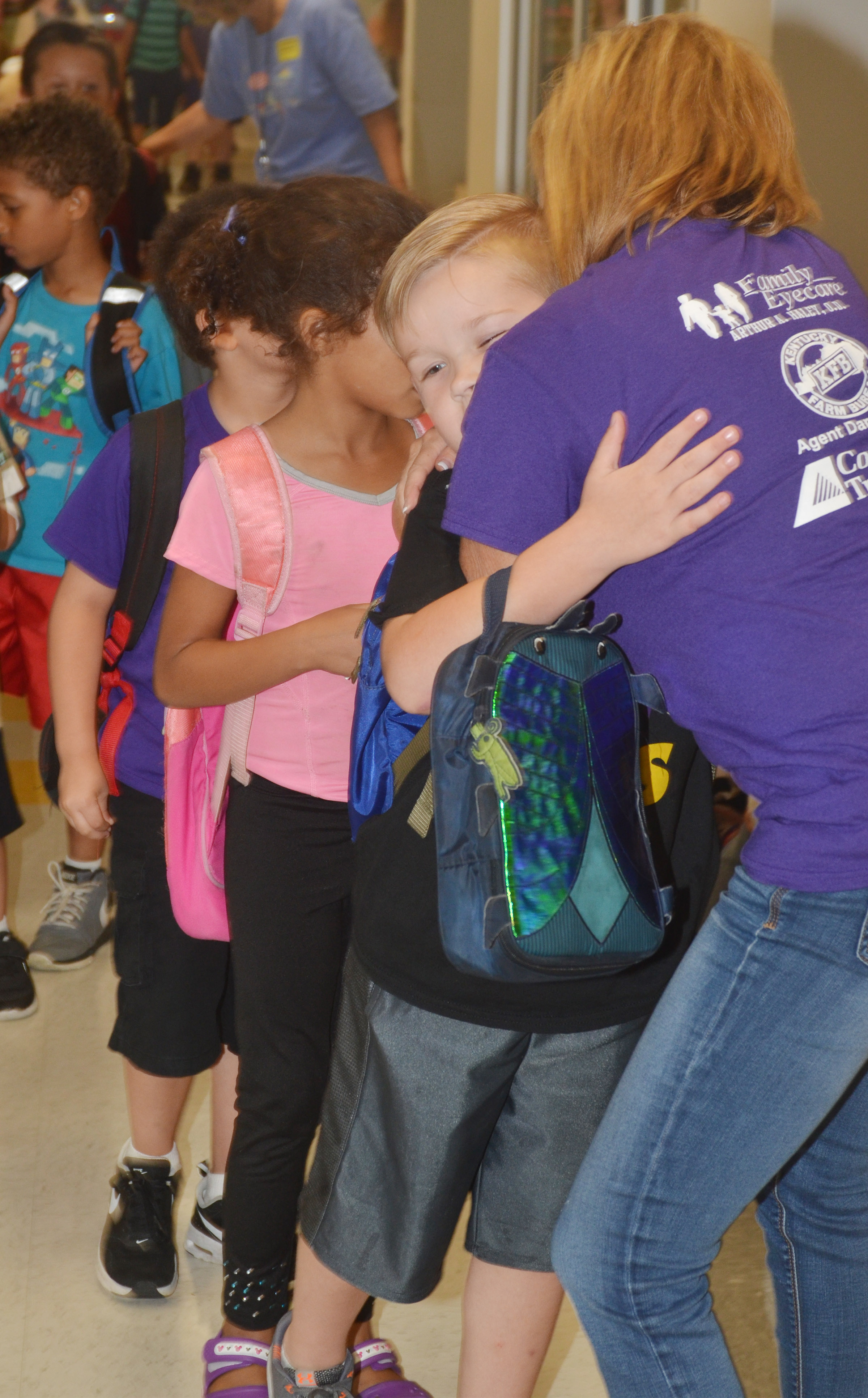 CES kindergarten teacher Lisa Wiseman hugs student John Hagan Newton at the end of the day.