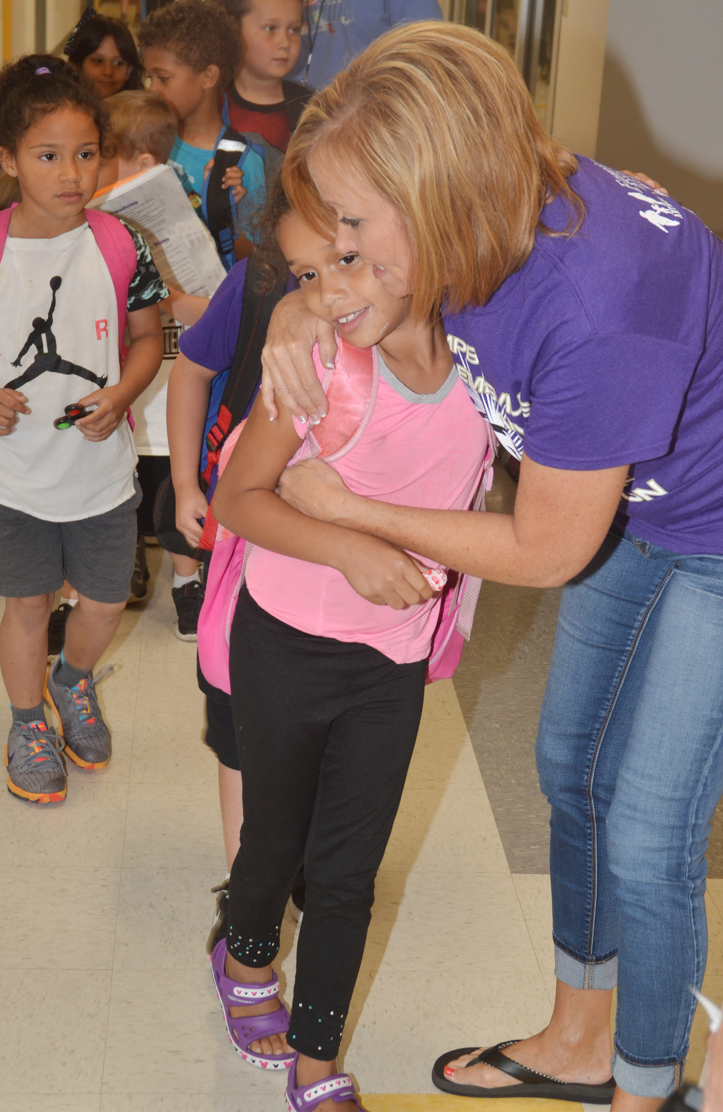 CES kindergarten teacher Lisa Wiseman hugs student Jyra Welch as she gets ready to go home.