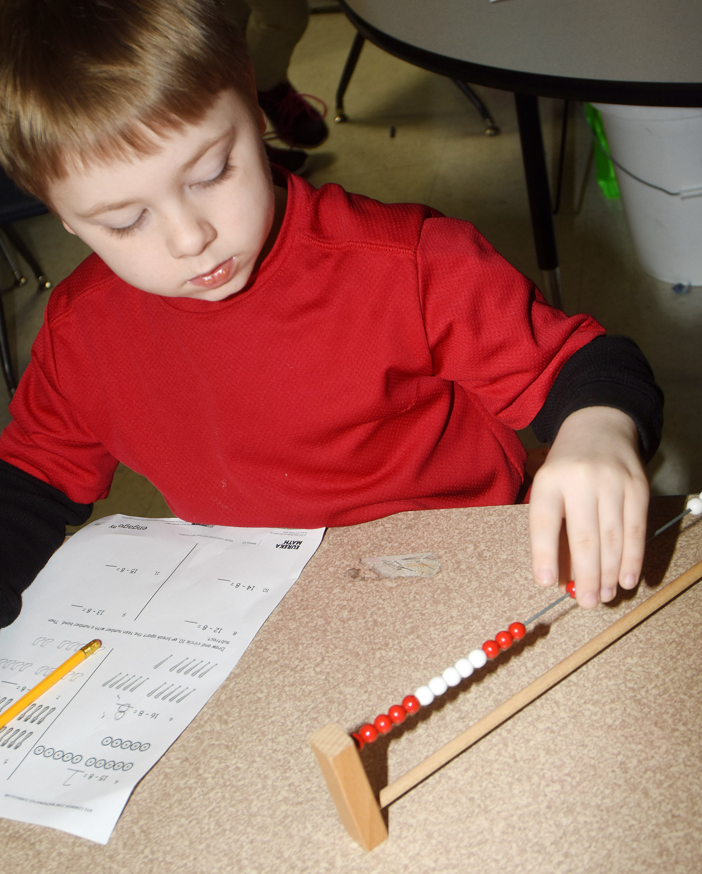 CES first-grader Noah Milburn uses an abacus to help him subtract.
