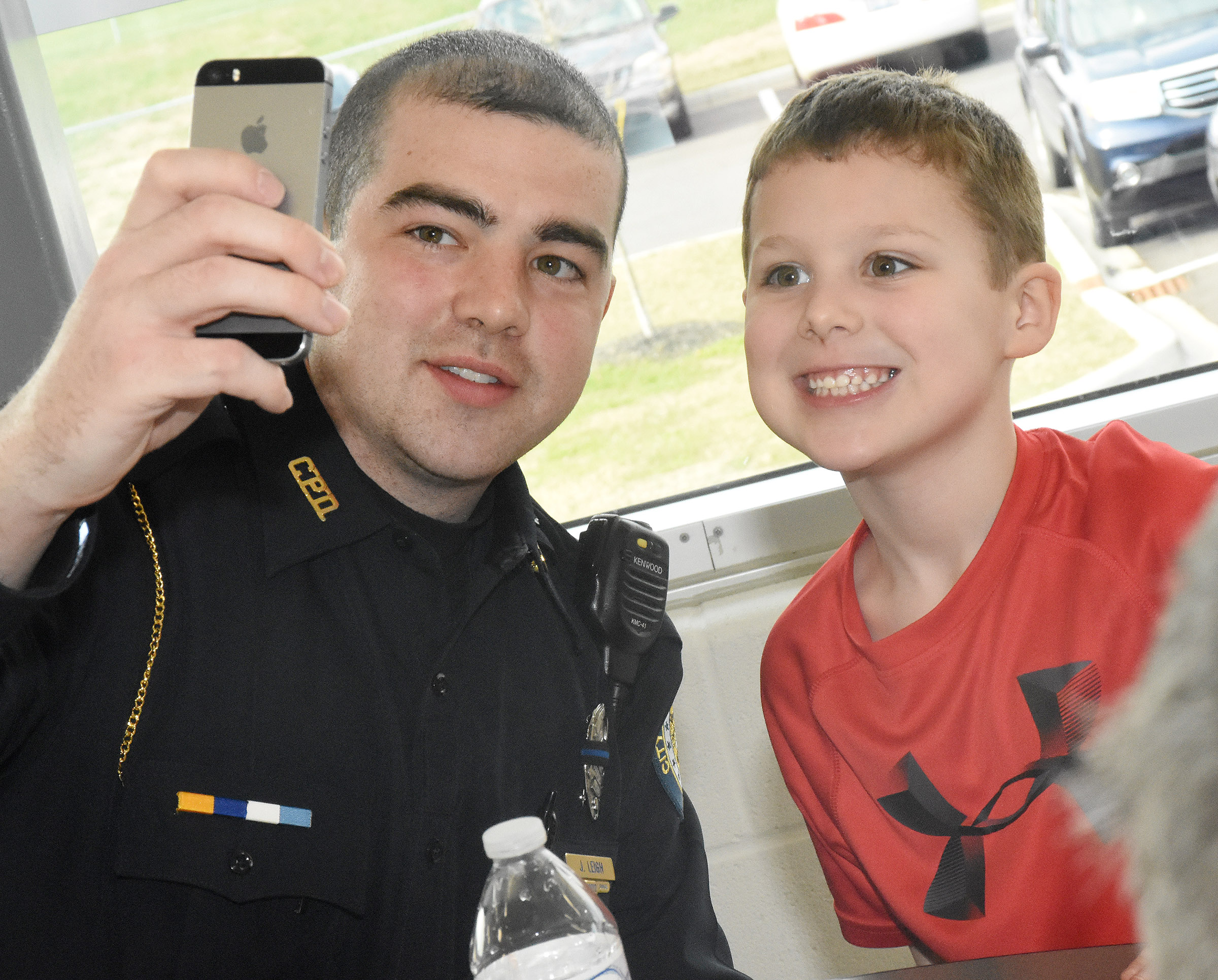 CES kindergartener Kyler Wilson takes a selfie with Campbellsville Police Officer Jonathan Leigh.