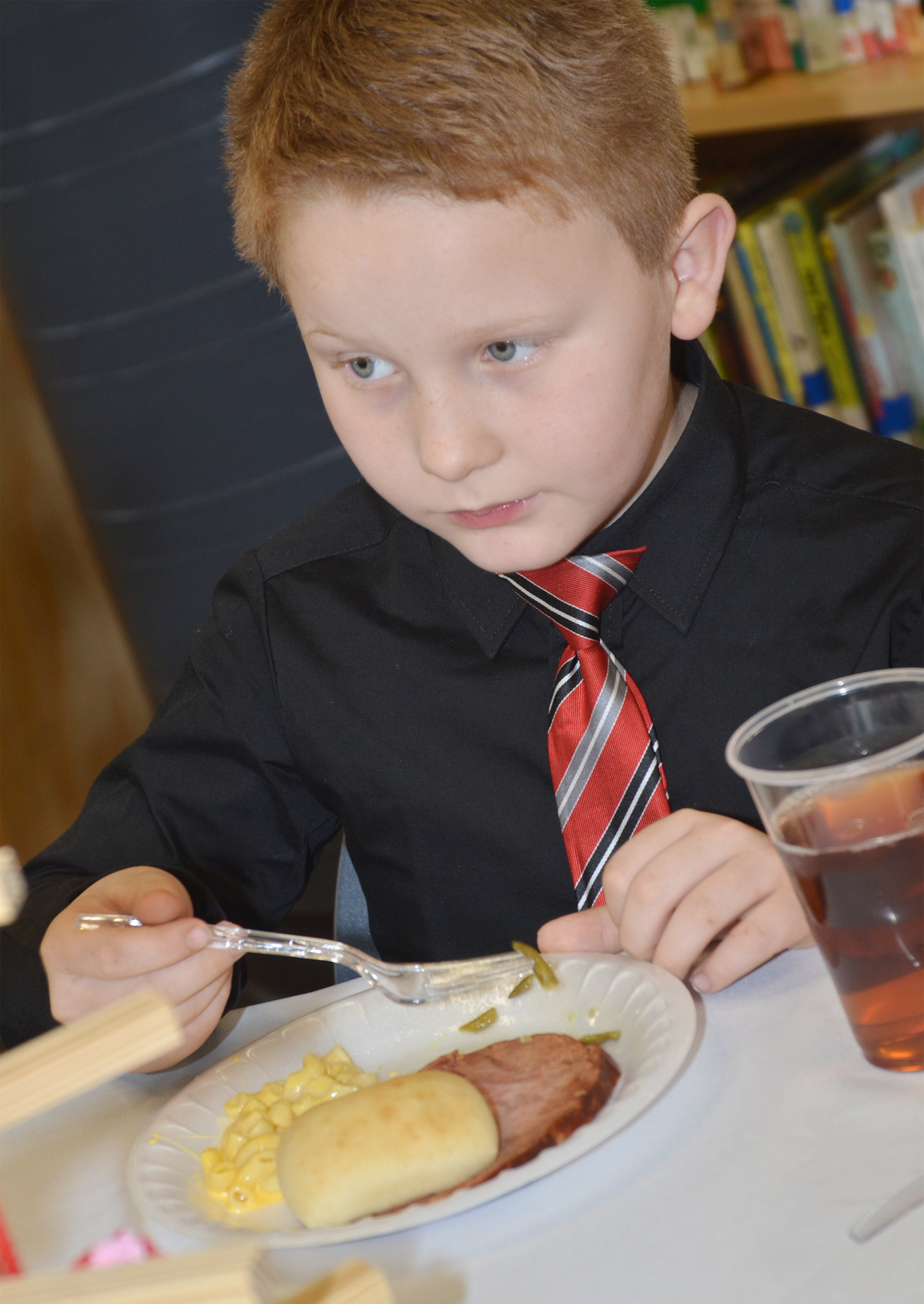CES third-grader Isaiah Jeffries eats lunch.