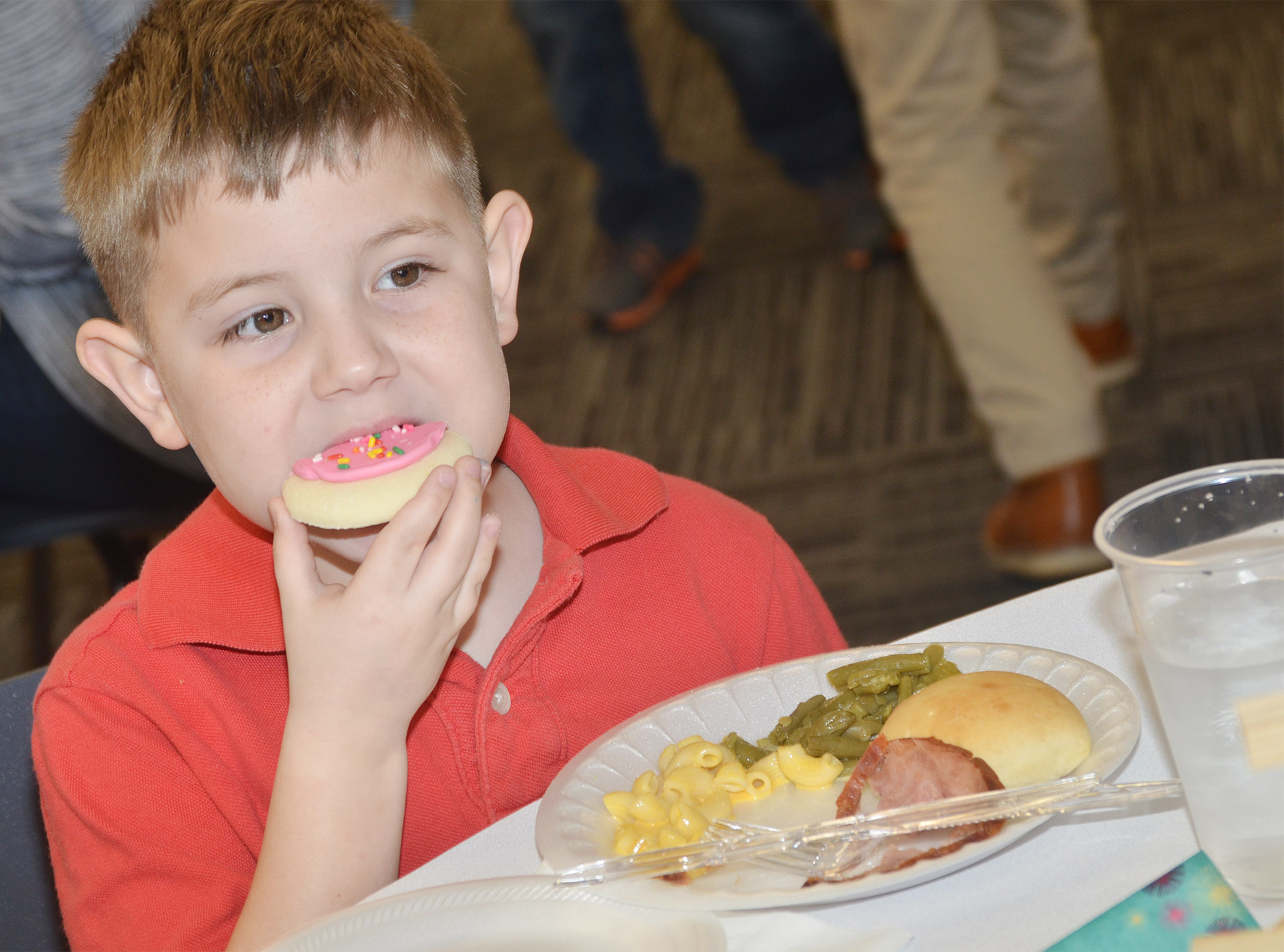 CES second-grader Seamus Huber eats a cookie.