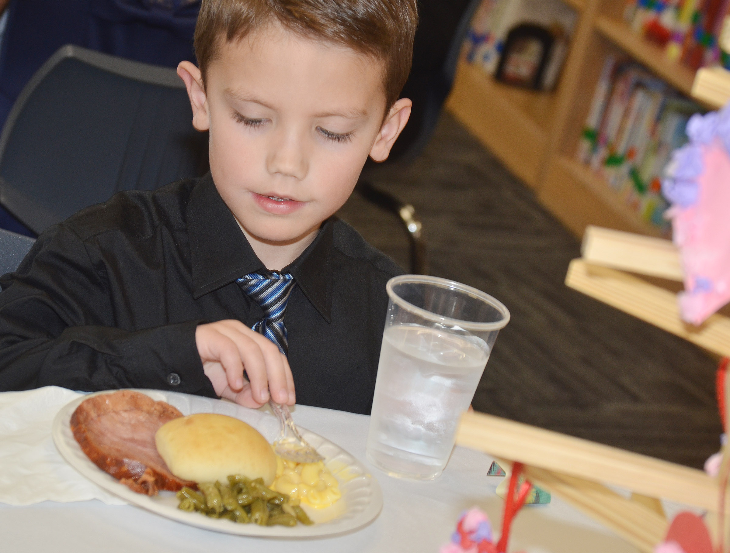CES first-grader Owen Skaggs enjoys his lunch.