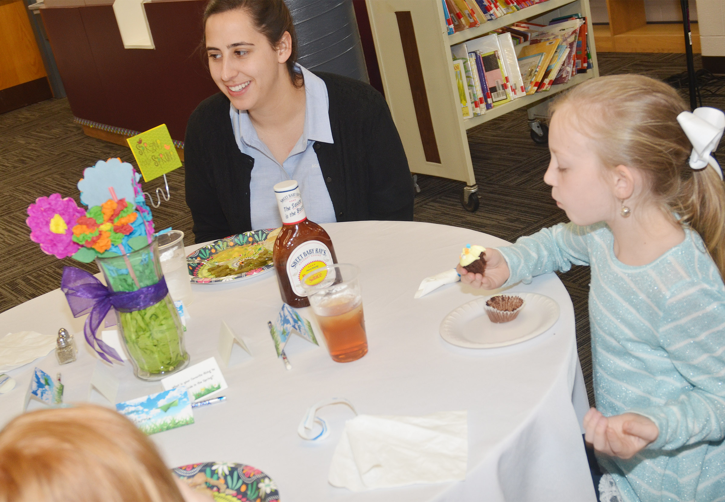 Abi Waldrupe, reference librarian at Campbellsville University's Montgomery Library, has lunch with third-grader Kendall Bright.