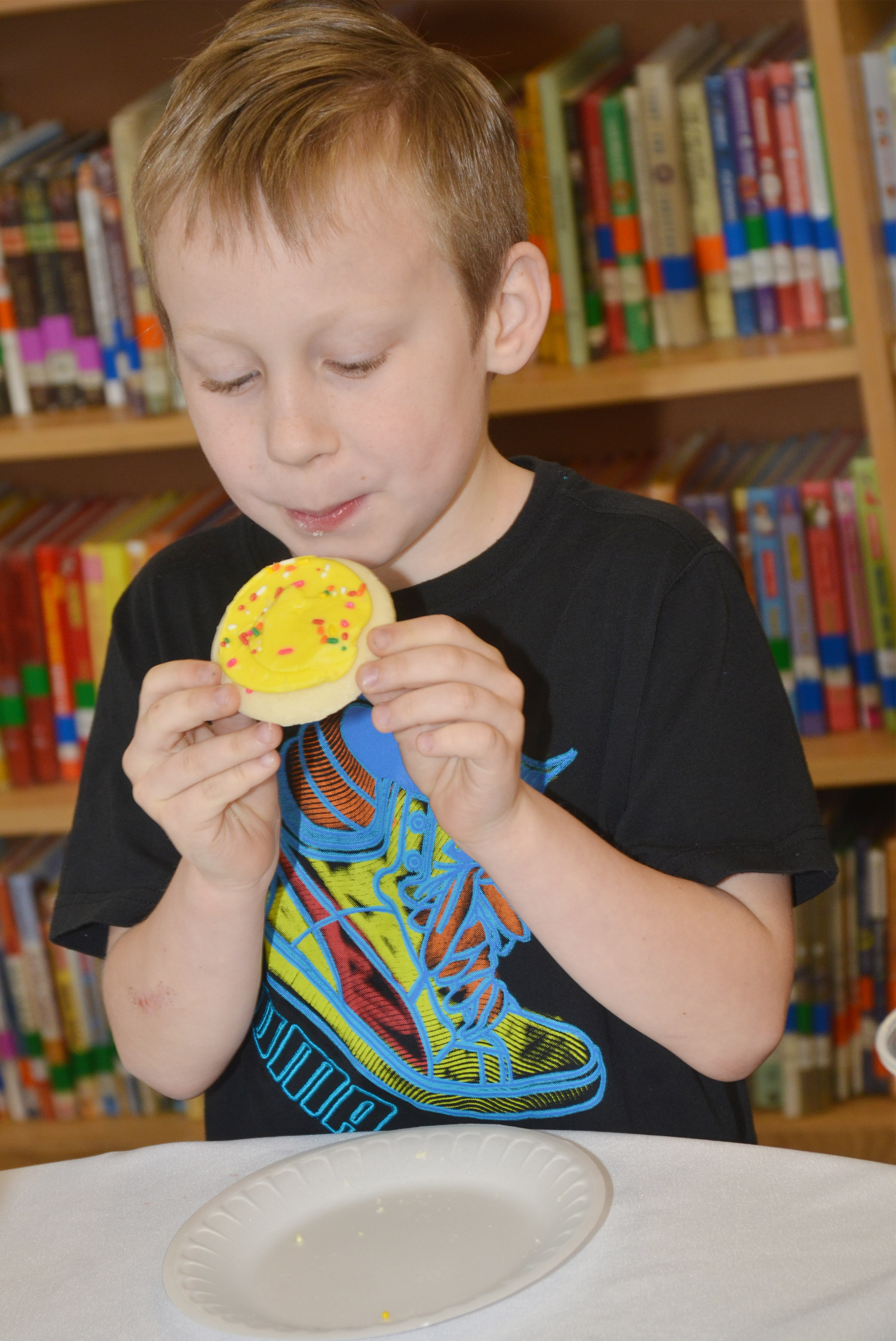 CES first-grader Raleigh Spencer enjoys a cookie.