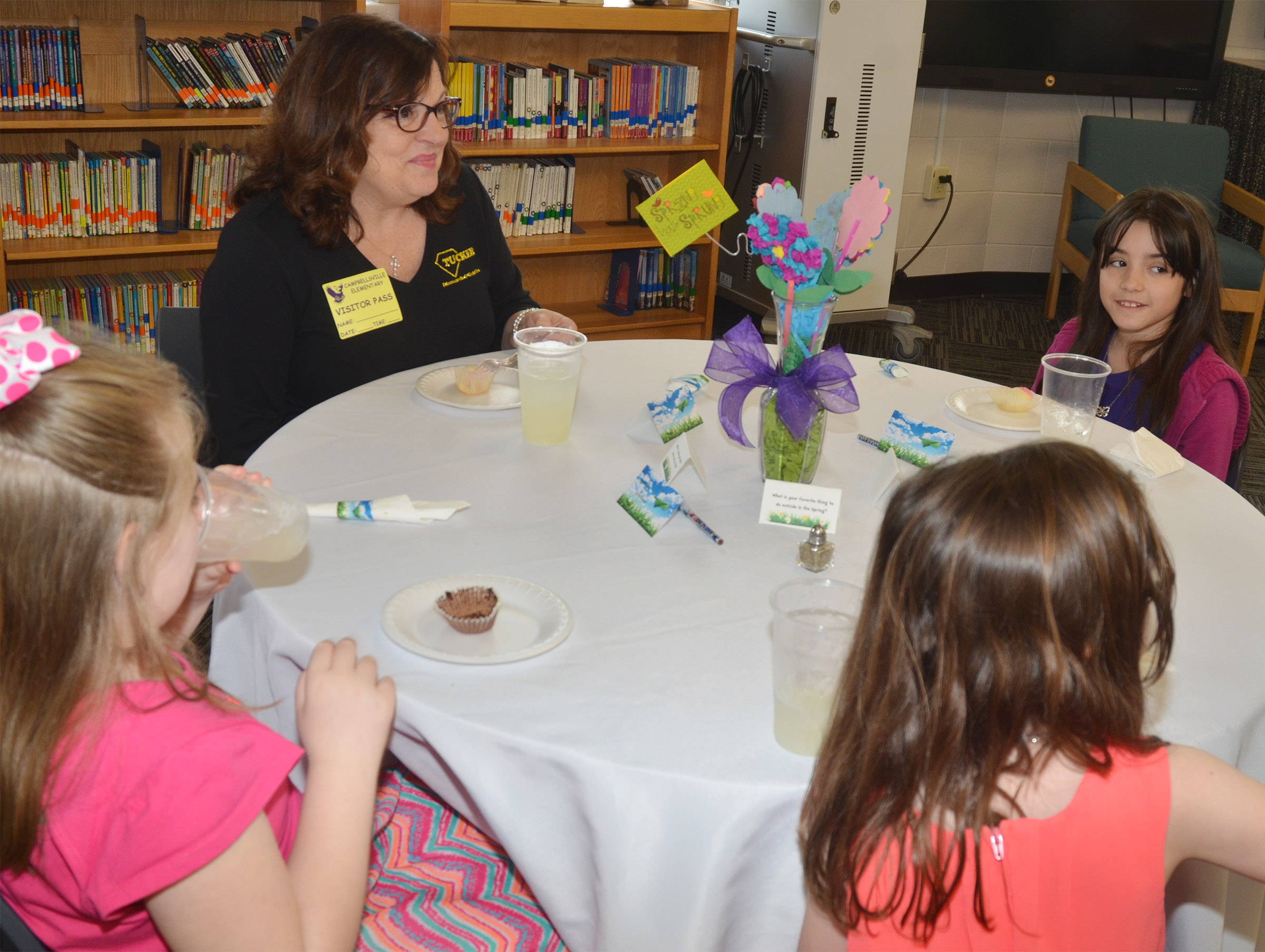 Kathleen Tucker, owner of Tucker Diamonds & Gold has lunch with, from left, first-graders London Whitlow and Anna Keith and third-grader Evangeline Bledsoe.