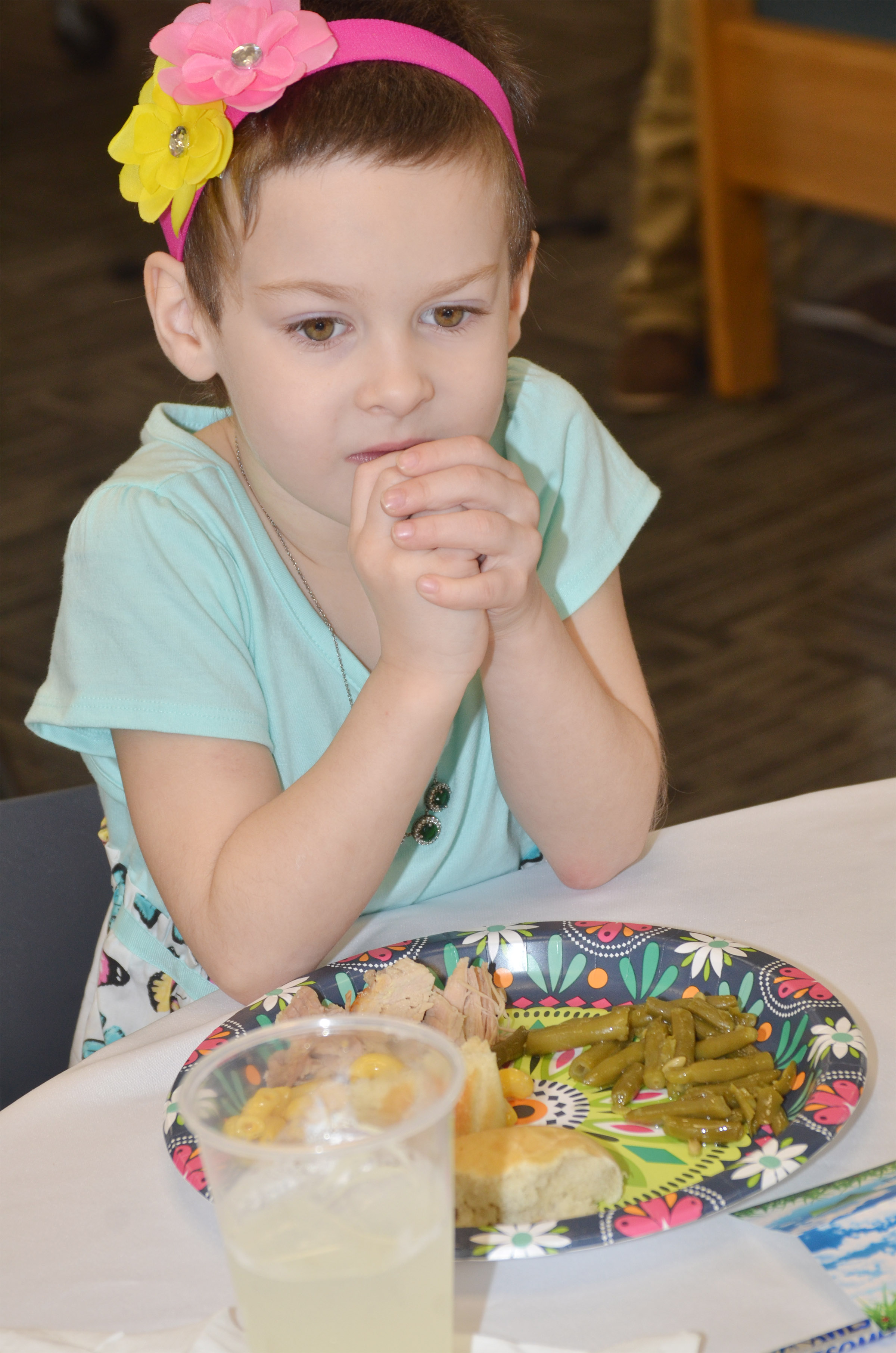 CES kindergartener Madison Haywood waits to eat her lunch.