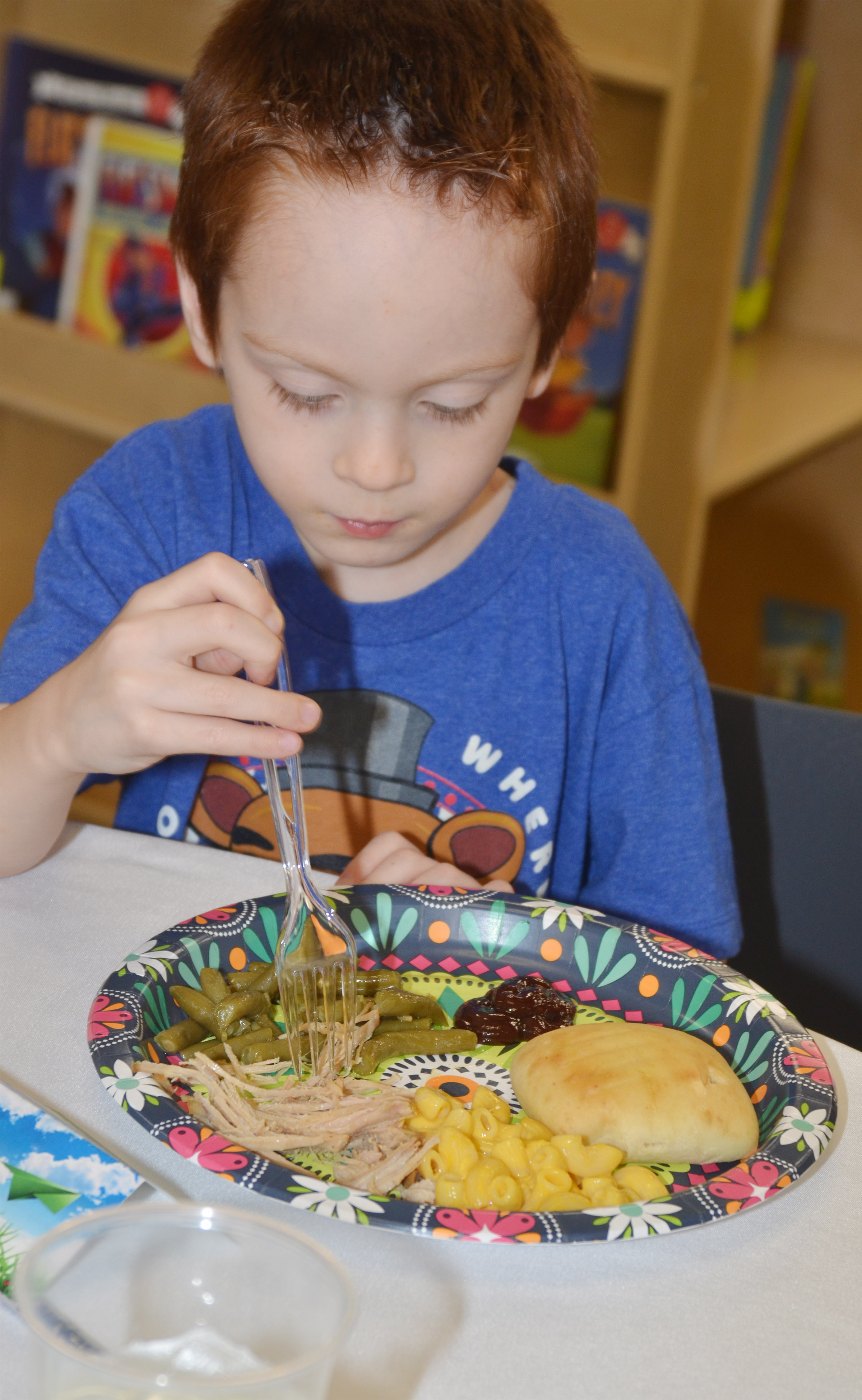 CES kindergartener Carson Montes enjoys his lunch.