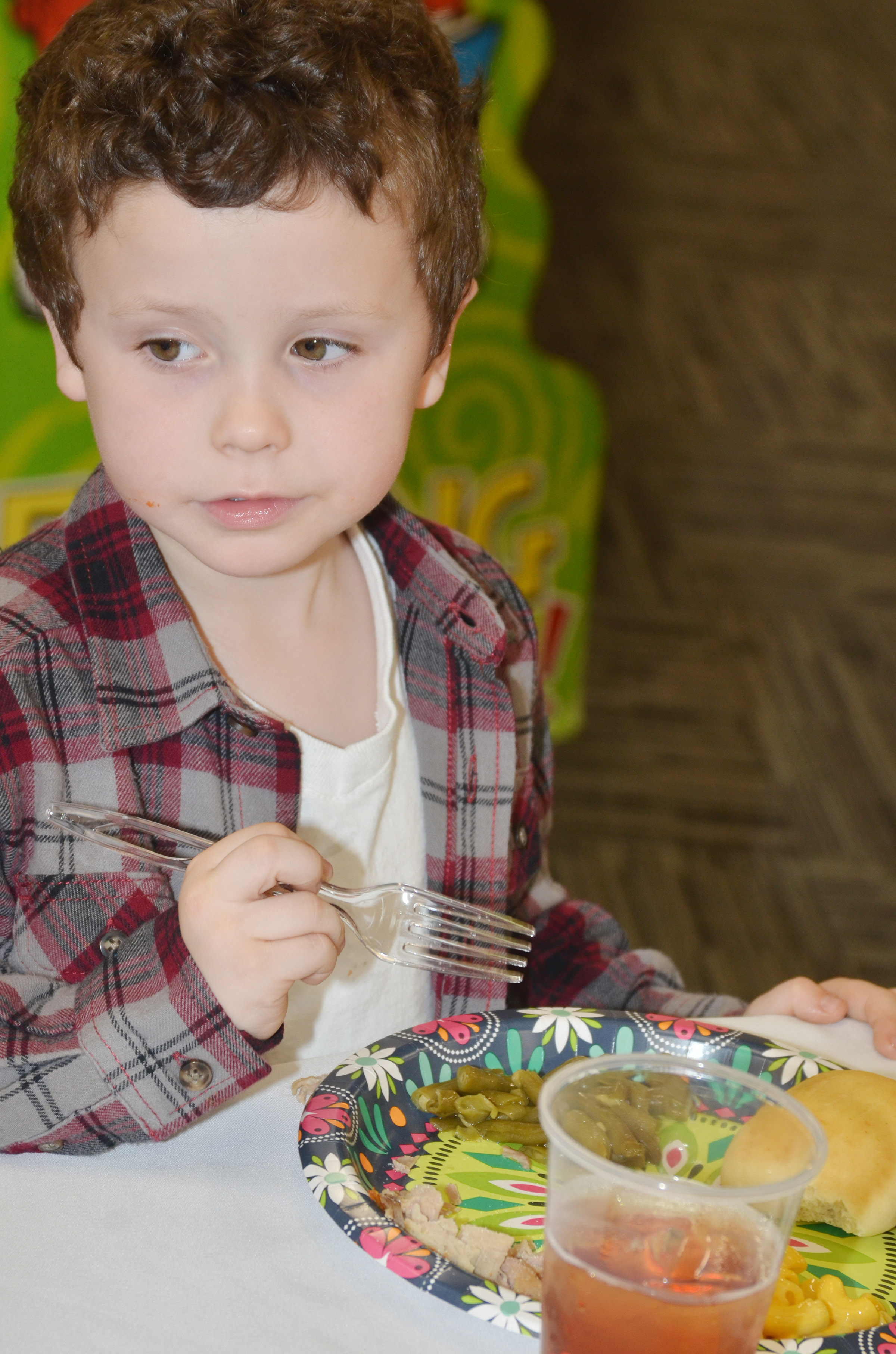 CES kindergartener Braydan Dyer eats his lunch.
