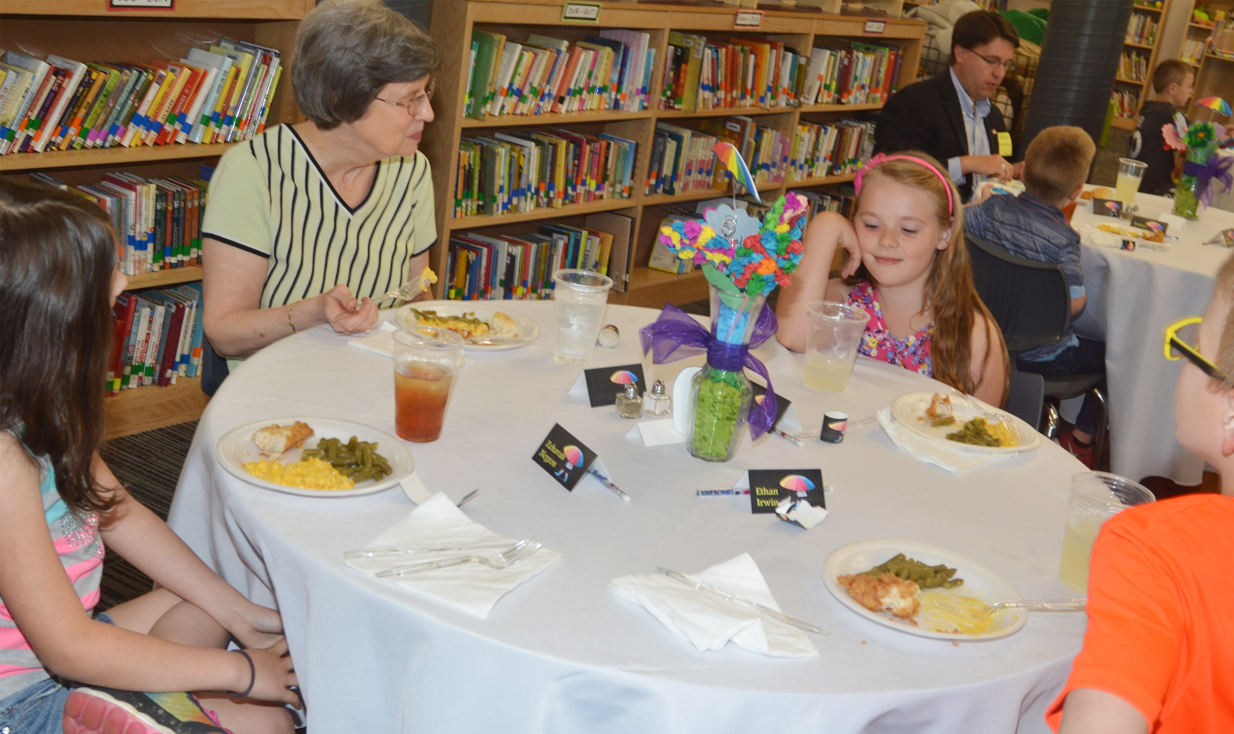Local author Diana Derringer has lunch with, from left, CES third-grader Zehavah Negron, second-grader Caleigh Underwood and third-grader Ethan Irwin.