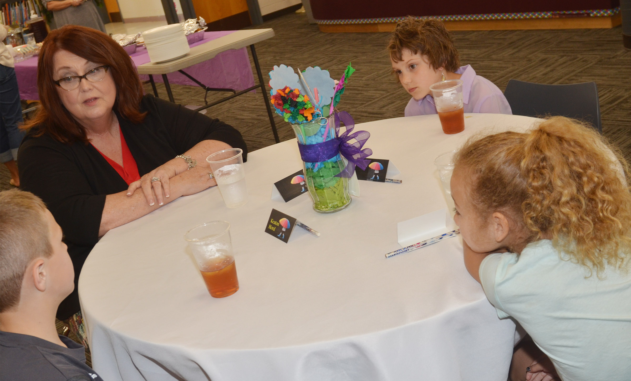 Peggy Richardson, director of counseling services at Campbellsville University, talks with, from left, CES third-grader Keaton Hord, second-grader Baylee Pike and third-grader Raelyn Dunn.