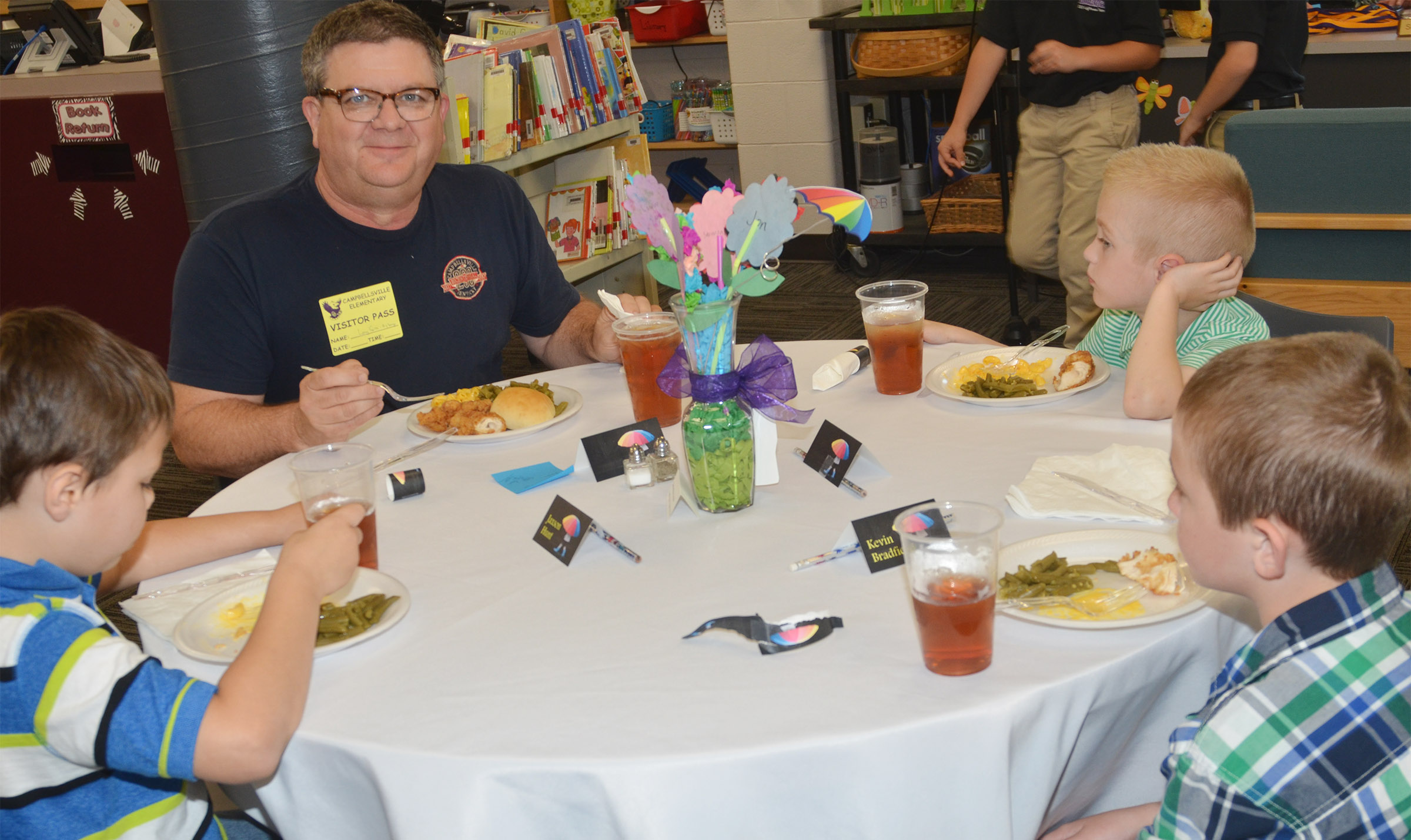 WLVC Operations Manager Larry Smith has lunch with, from left, CES first-grader Jaxson Hunt, second-grader Evan Cundiff and first-grader Kevin Bradfield.