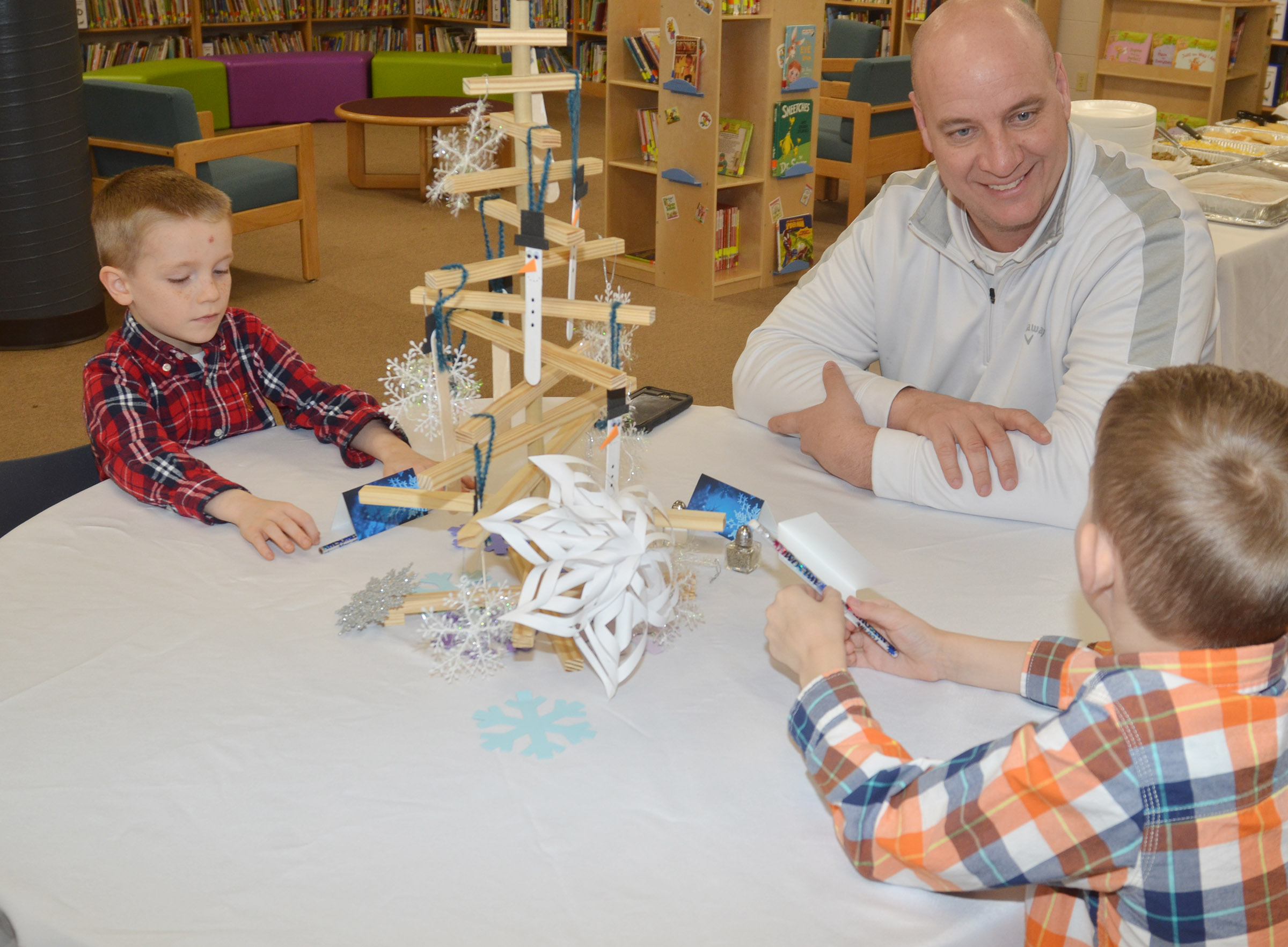 Campbellsville Independent Schools Director of District Wide Services and Transportation Director David Petett has lunch with kindergartener Jason Eggers, at left, and first-grader Logan Weddle.