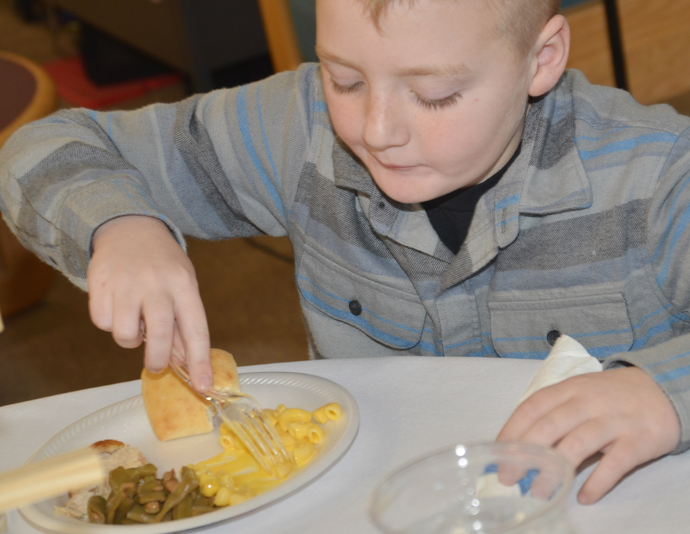 CES third-grader Ryder Murphy eats his macaroni and cheese.
