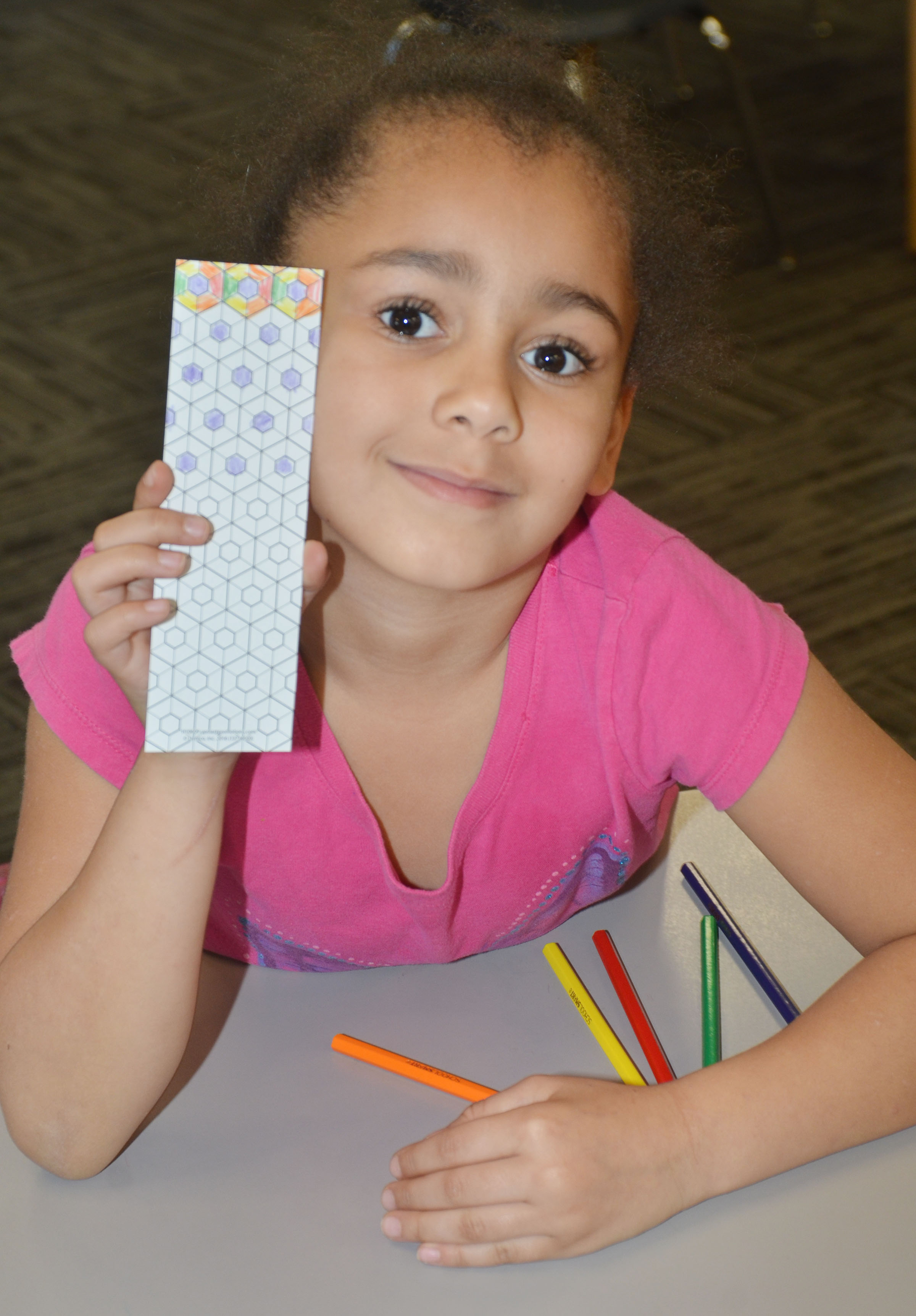 CES first-grader Keitona Whitehead colors a bookmark at the library.