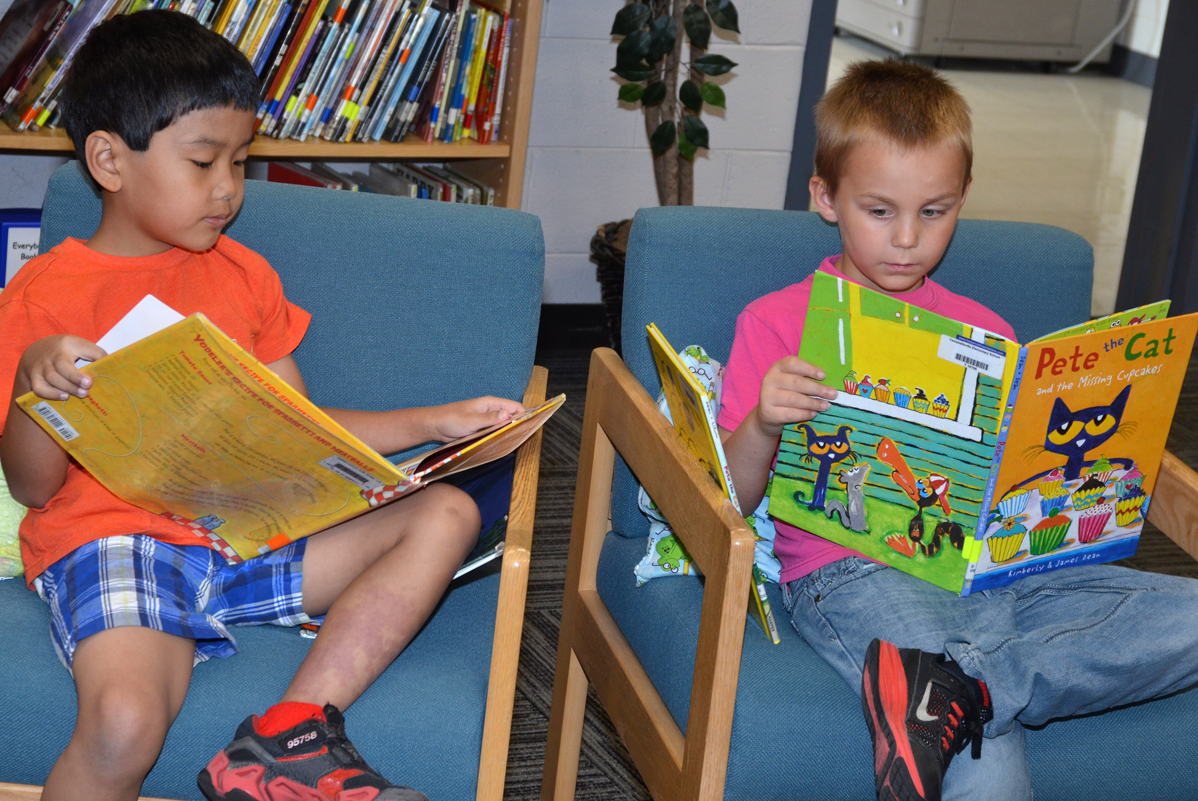 CES second-graders Zach Hak, at left, and Hunter Bates read together.