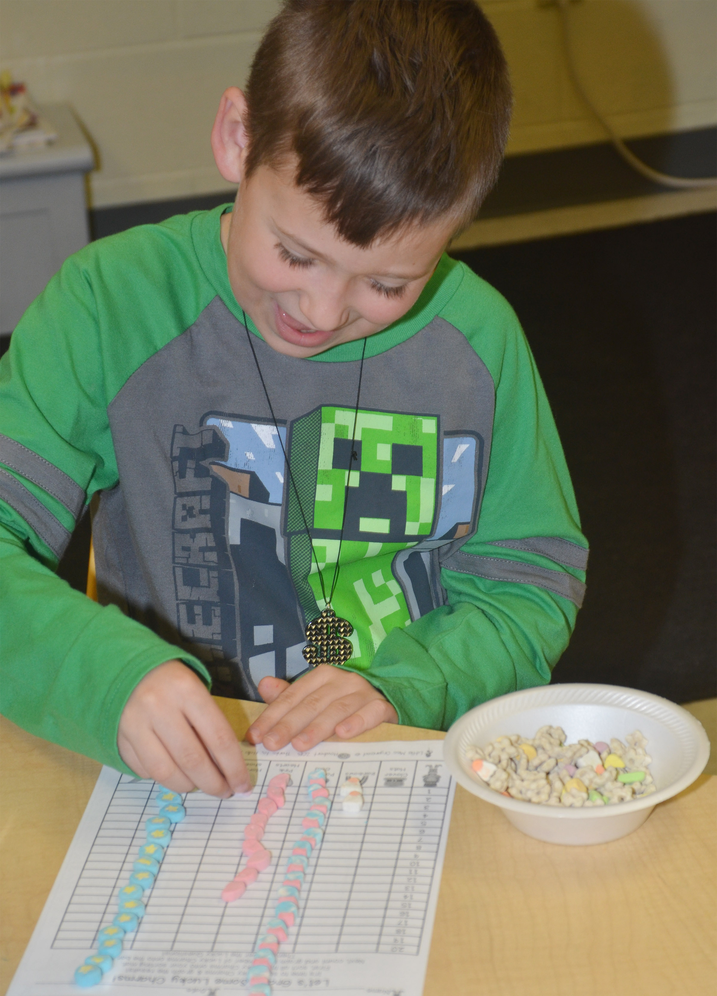 CES second-grader Emerson Dengel sorts his Lucky Charms marshmallows.
