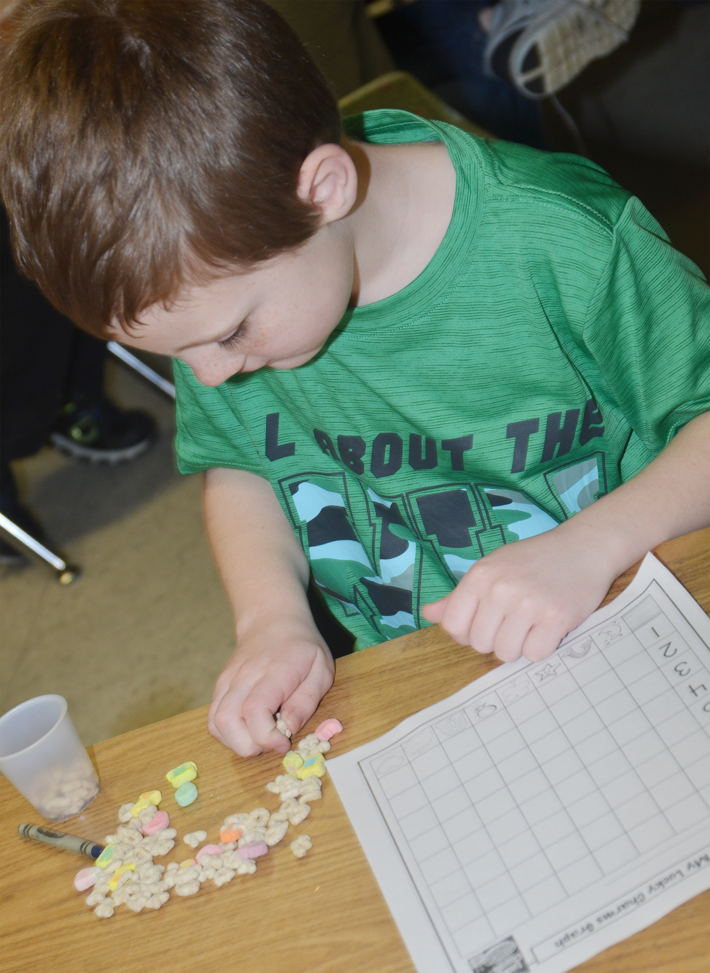 CES first-grader James Brunner sorts his Lucky Charms marshmallows.