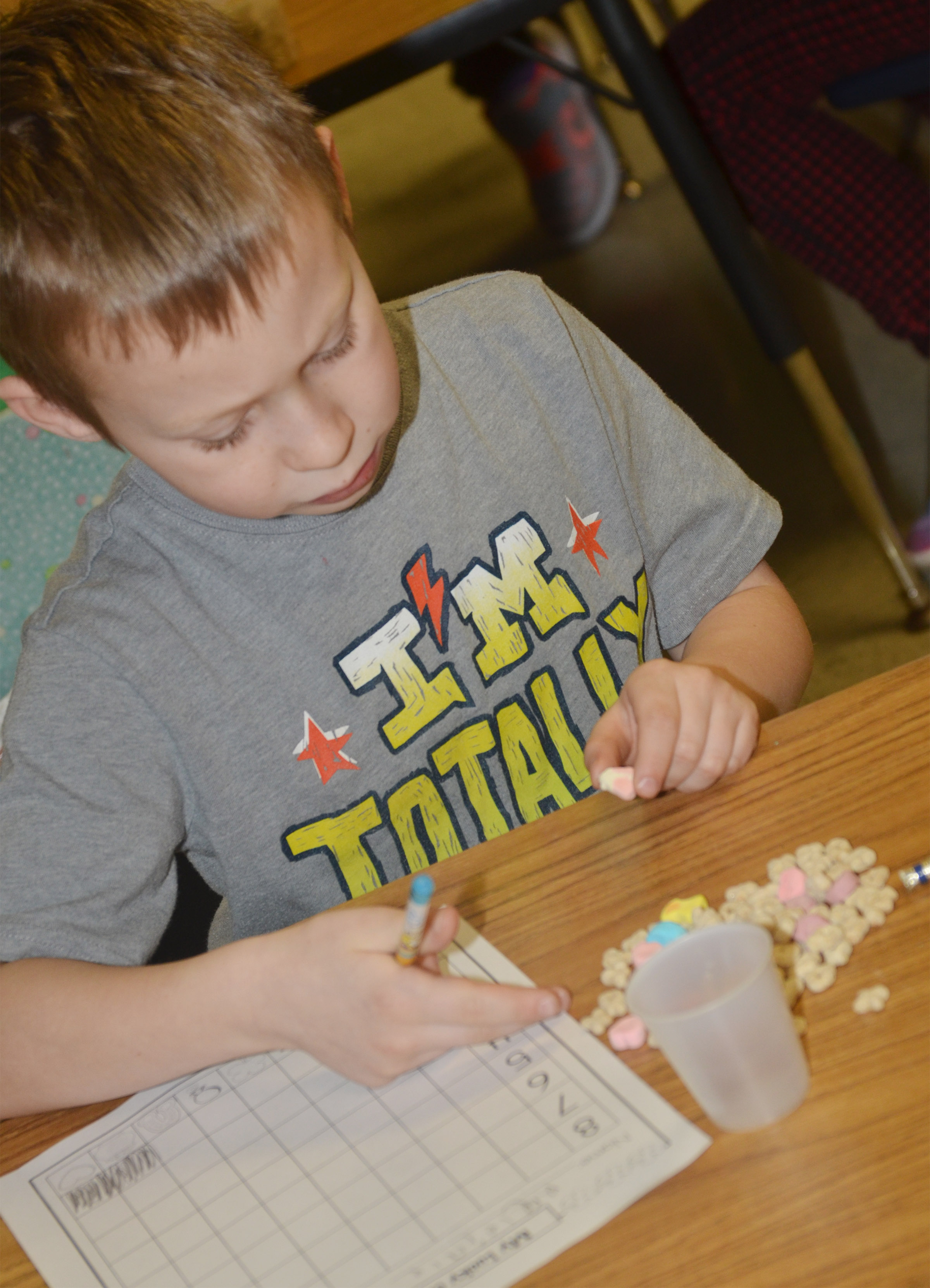 CES first-grader Raleigh Spencer sorts his Lucky Charms marshmallows.